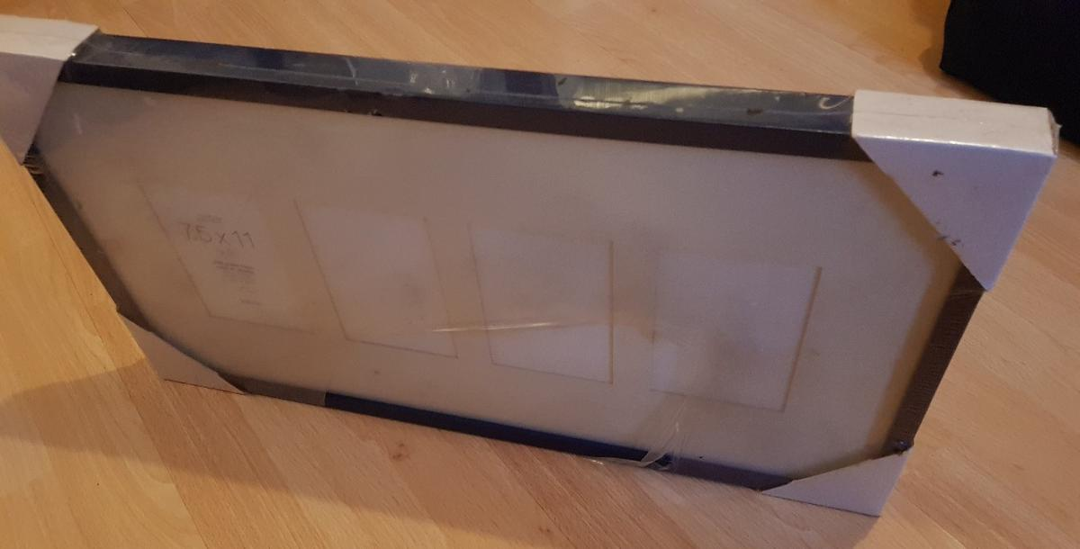 This is a dark blue hanging picture frame that can hold up to 4 pictures. Brand new from Habitat. Never used. Colour ever so slightly snatched on the frame where the plastic packaging came away at the top.
