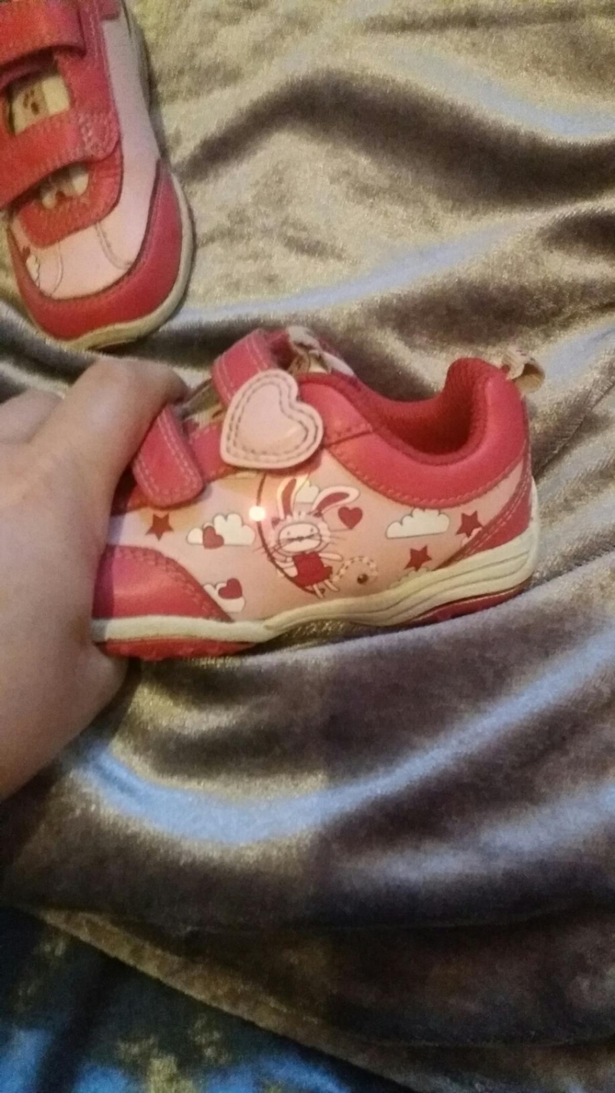 Pink and white toddler girls trainers. velcro fasten. They light up when they walk. Only worn a few times. Fab condition. pick up only