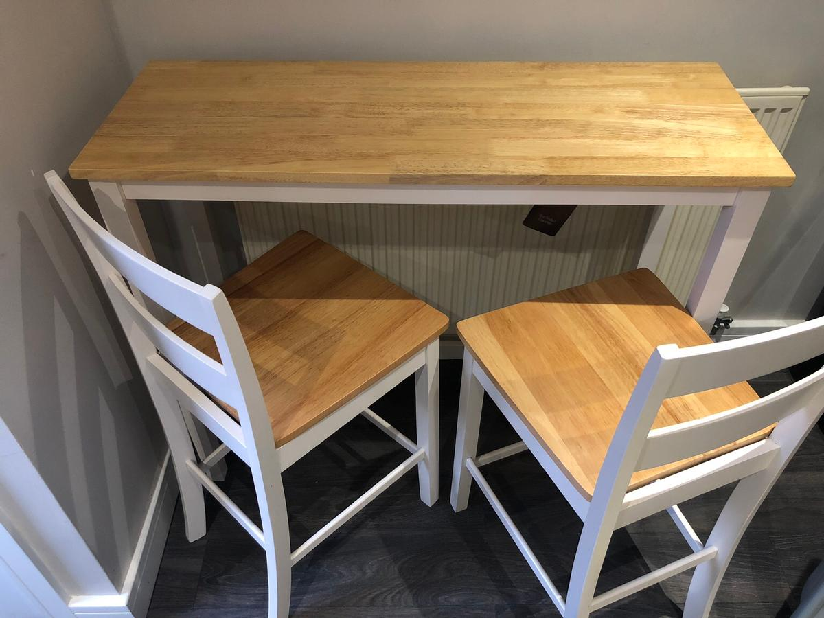 Amazing condition bar table and x2 stools. Displayed in kitchen only, only used a handful of times if that. Always had table cloth and cushions on stools so no marks at all just like brand new! Labels still on table and stools. Want half the price to what we originally paid.