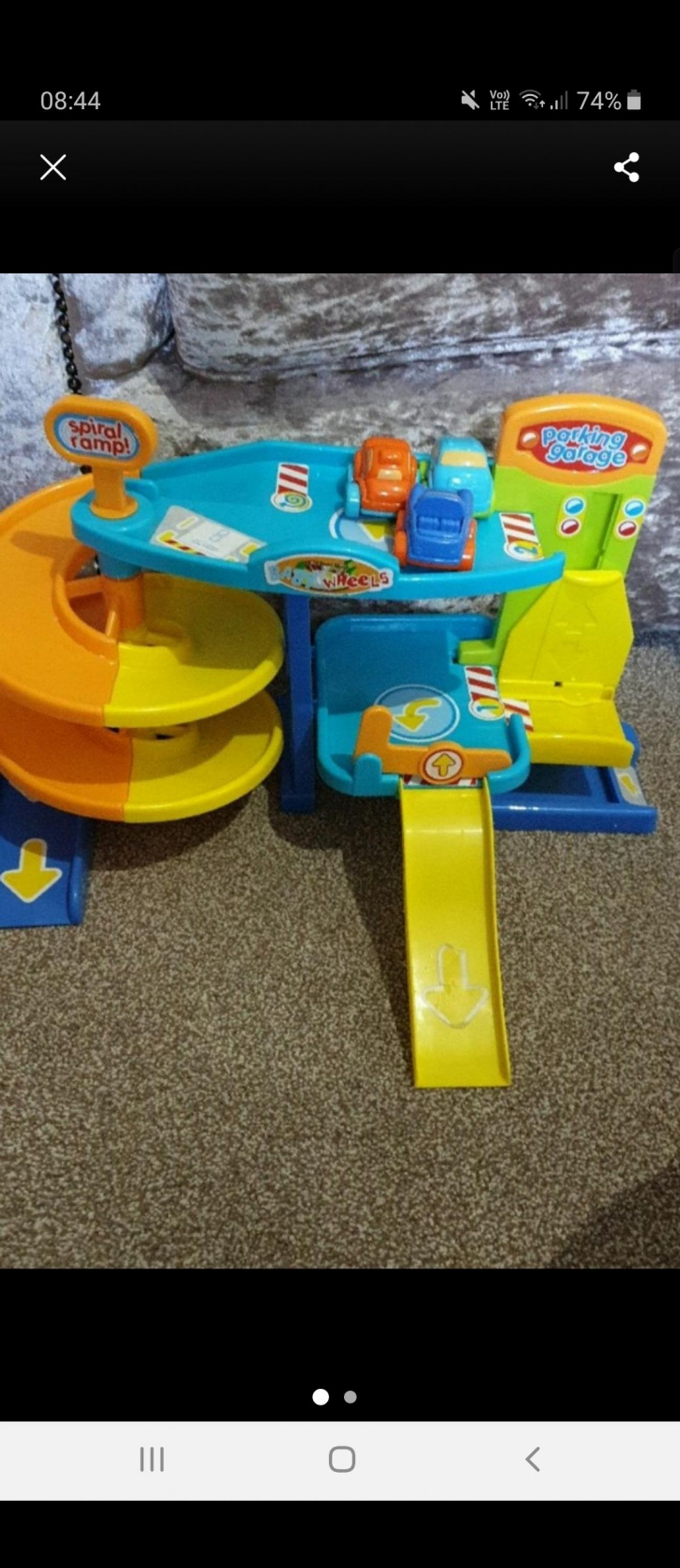 played with in good condition comes with 3 little cars everything dismantles easily