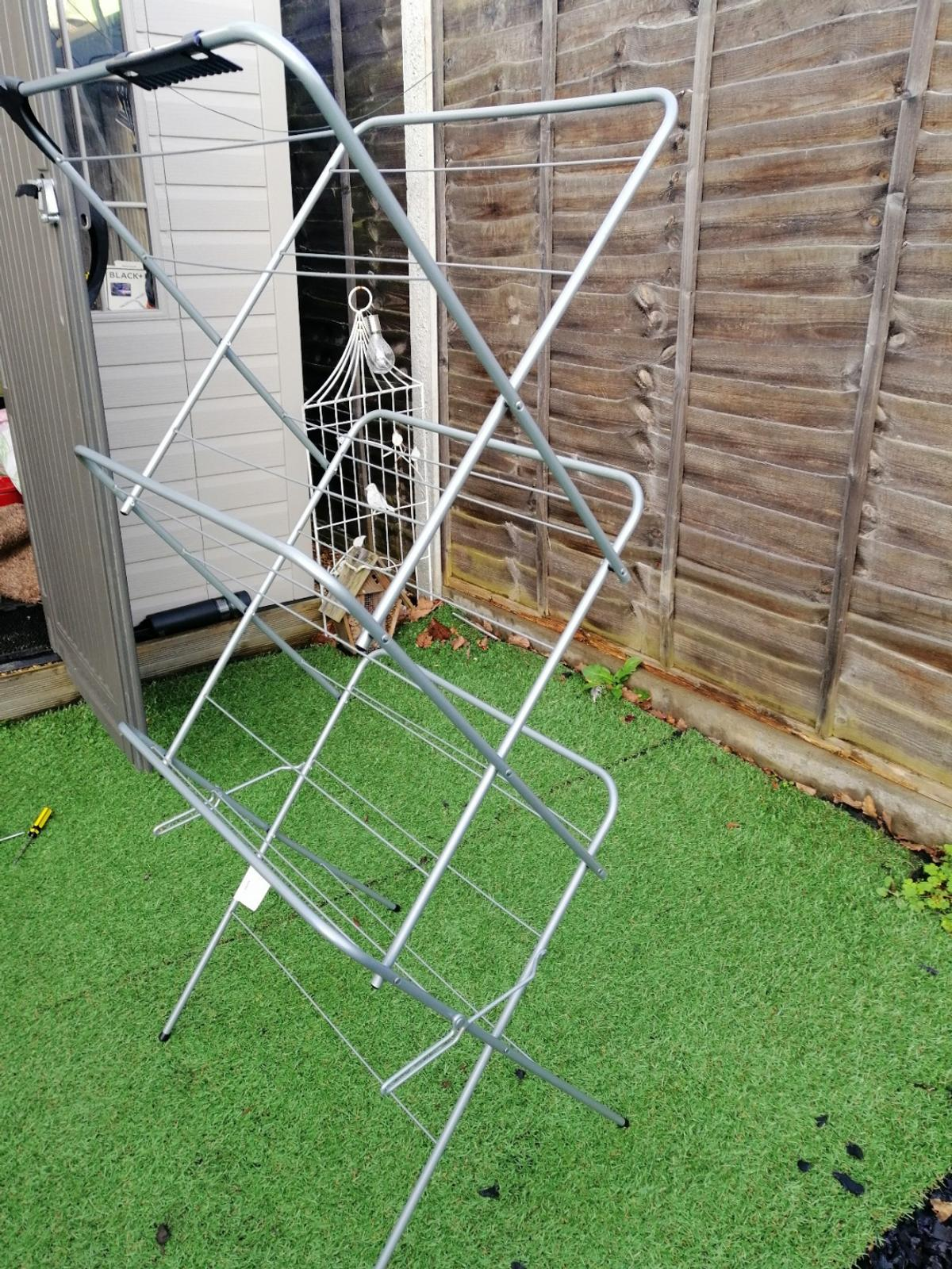 Handy compact size, folds when you need it. Holds up to 14 metres of washing with 3 tiers. Used few times. Handy coat hanger hooks included.