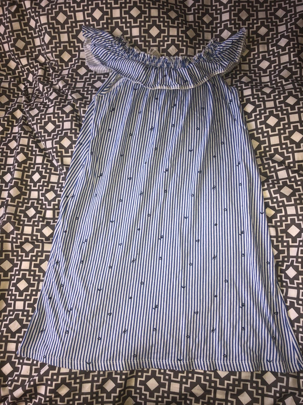 Off the shoulder dress blue and white striped with little hearts stars and moons  Age 11-12  No holding, on other sites too!