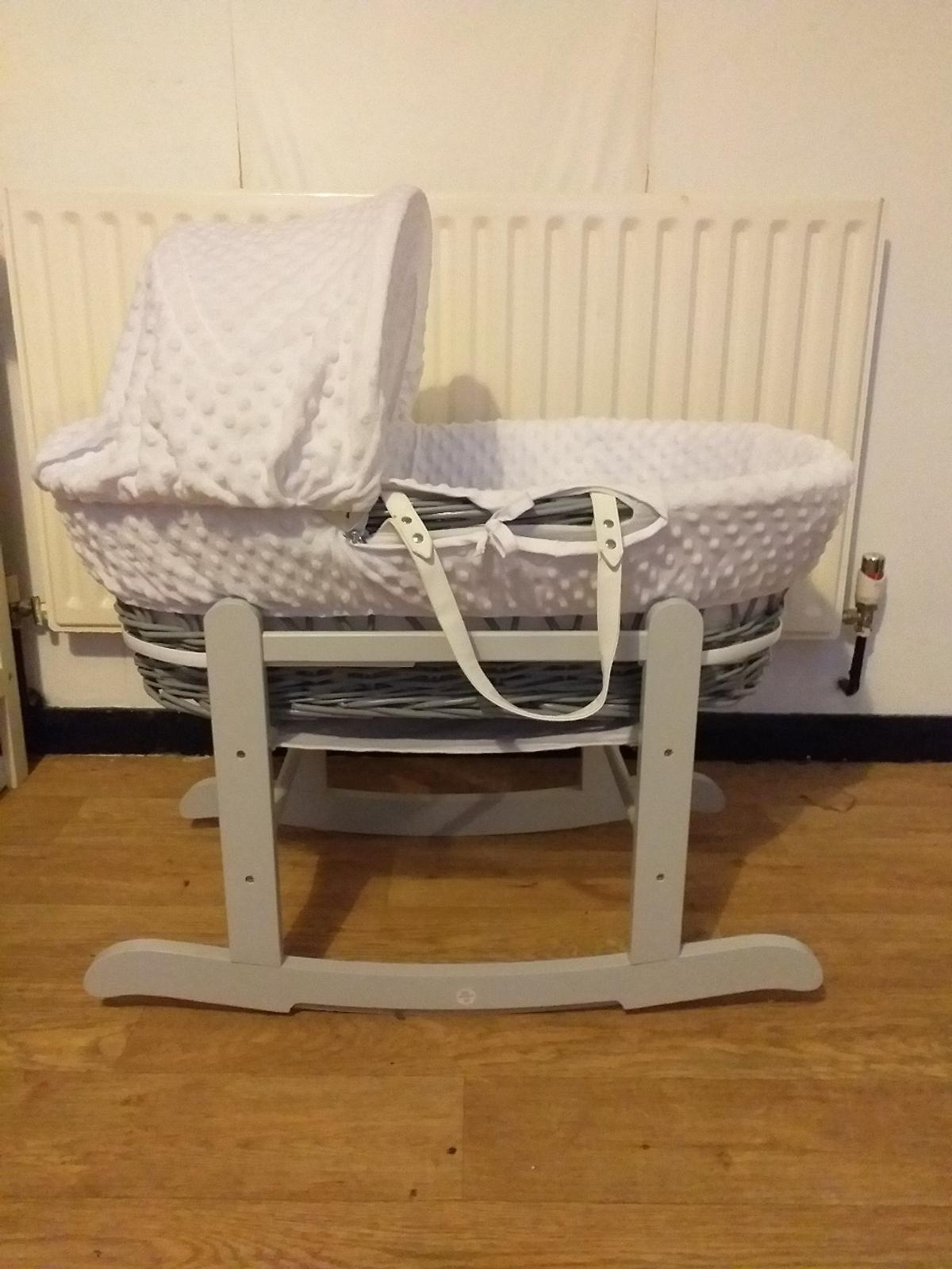 moses basket and rocking stand only used for 5 and a half weeks like new condition smaller moses basket, easier to take up and downstairs hood and inner material can be removed to be washed comes with 2 blue sheets