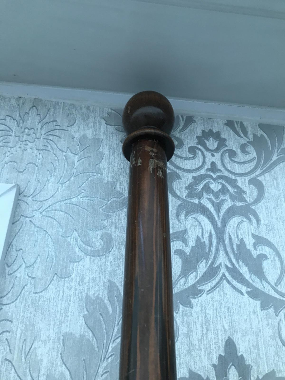 Heavy dark wood curtain bar Complete with rings and Heavy brass fitting Good solid wood 80 inch's length 6 inch round