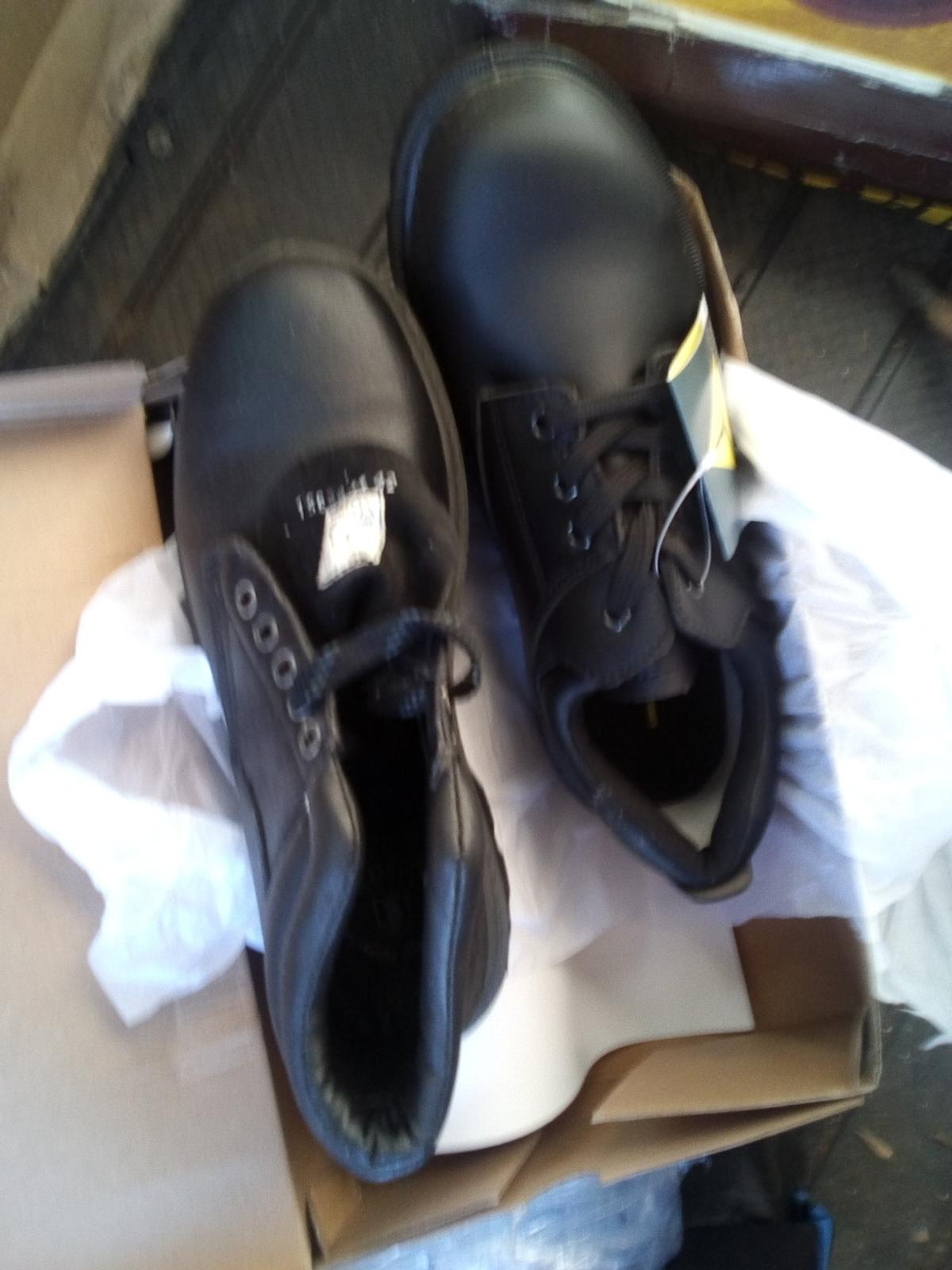 2 pairs men's working boots. never been worn. two pairs size 12.Ten pounds s pair . steel toe capped.