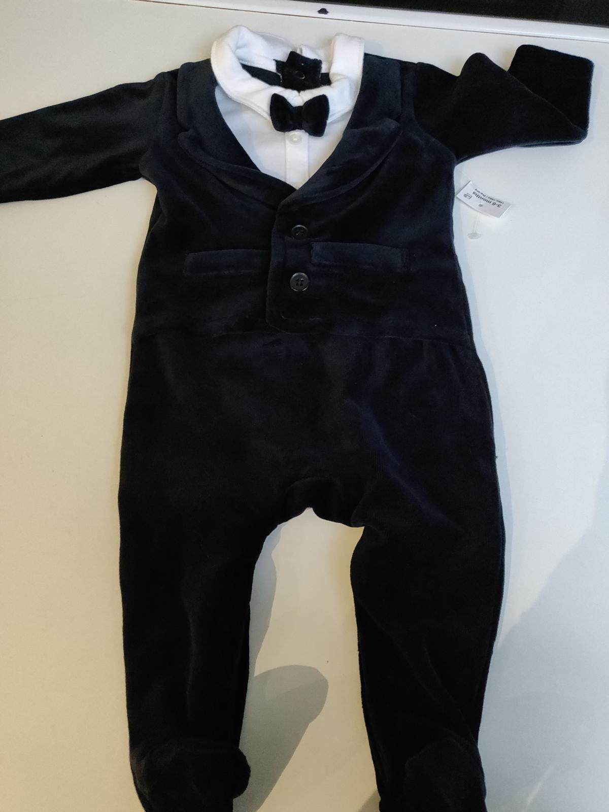 3-6 months, brand new with label. Baby feet warm velour all in one with attached bowtie