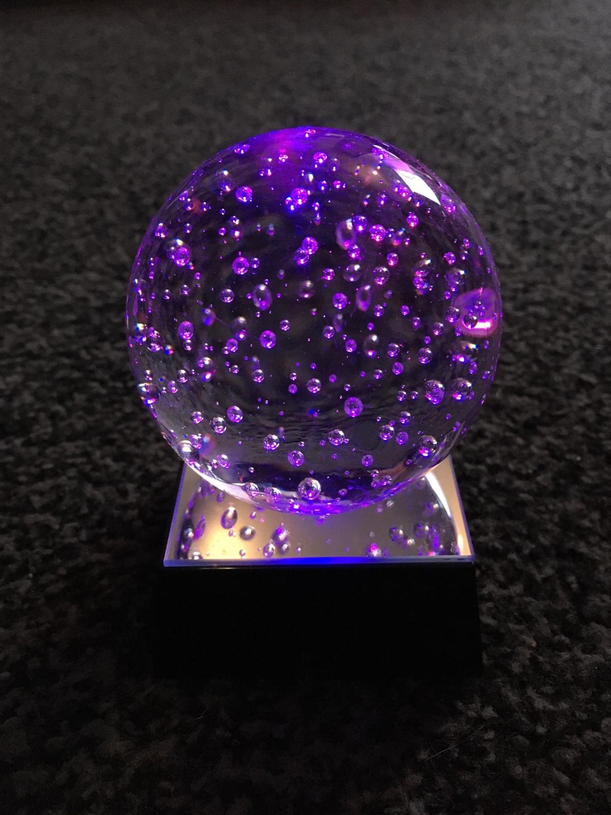 Glass bubble paperweight with stand that lights up different colours  Approx 6cm in diameter, stand slightly narrower
