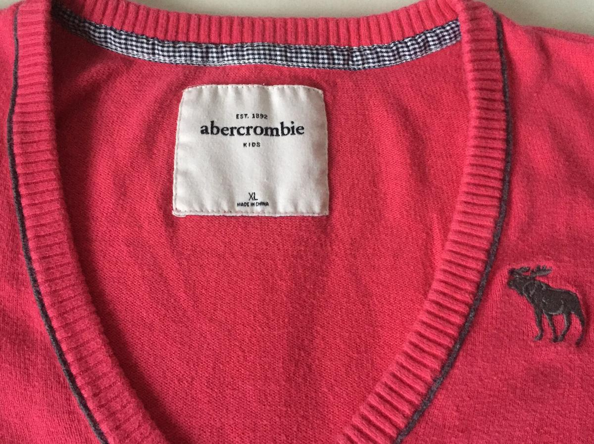 Abercrombie & Fitch v neck jumper, pink with grey trim and grey emblem. Kids size XL. I found with all A&F sizing that they come up smaller than actual size.