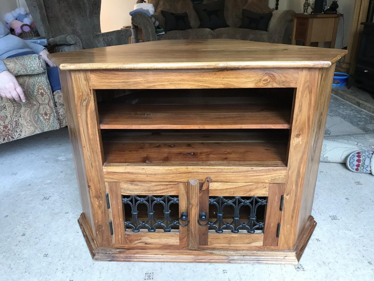 Good condition, wood tv stand. Two shelves with Two door cupboard at bottom Size width 89cm. Height 61cm Depth 58cm