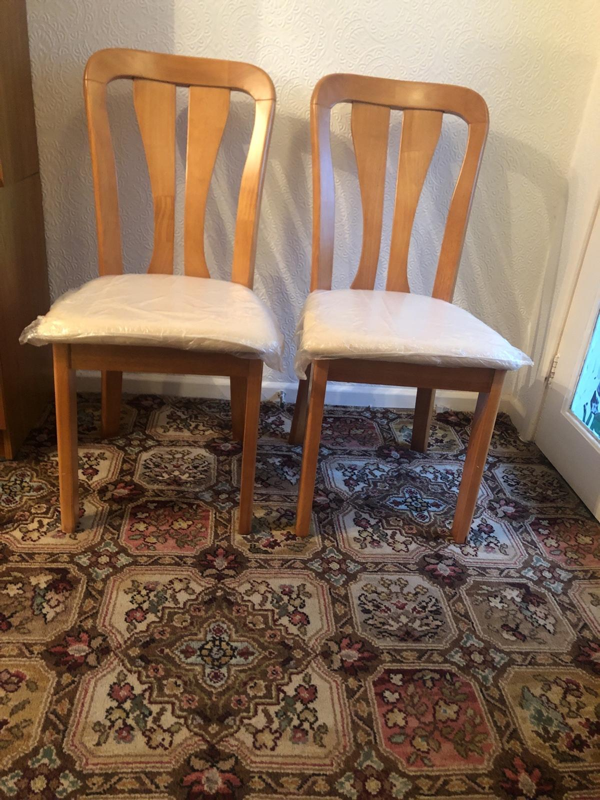 Cream material seats Still with polathean on Used twice for guests As new