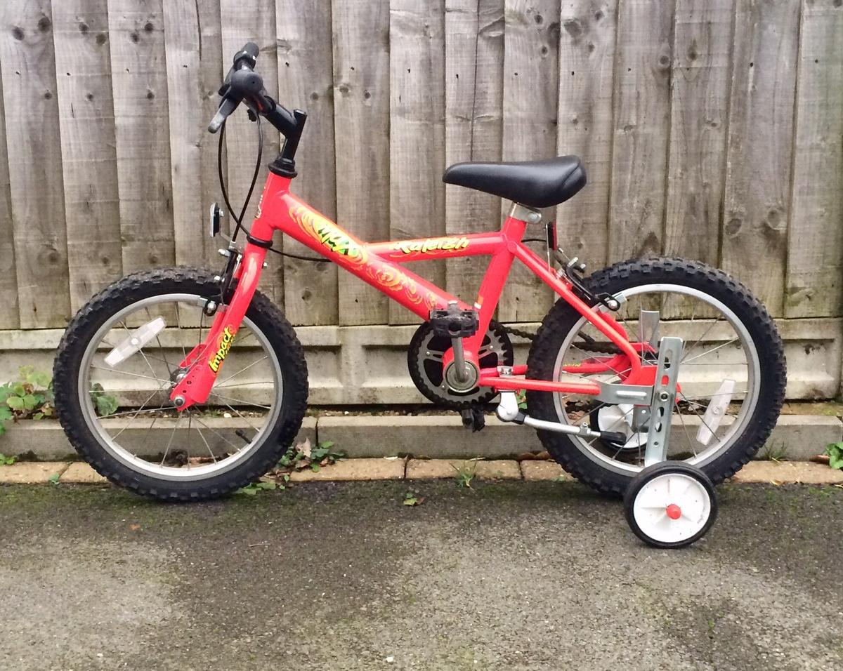 Kids Raleigh Max Bike Age 3+ Comes complete with stabilisers and stand. Very good condition as hardly used. Ideal birthday gift Any questions please ask