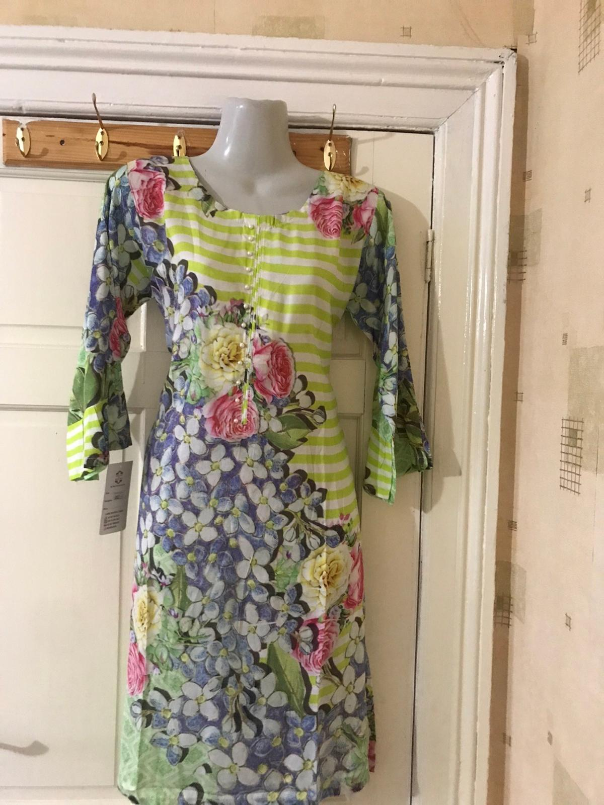 "Pearl added on neckline. Beautiful colour combination floral printed medium 38"" kurti can be wear with jeans or leggings"
