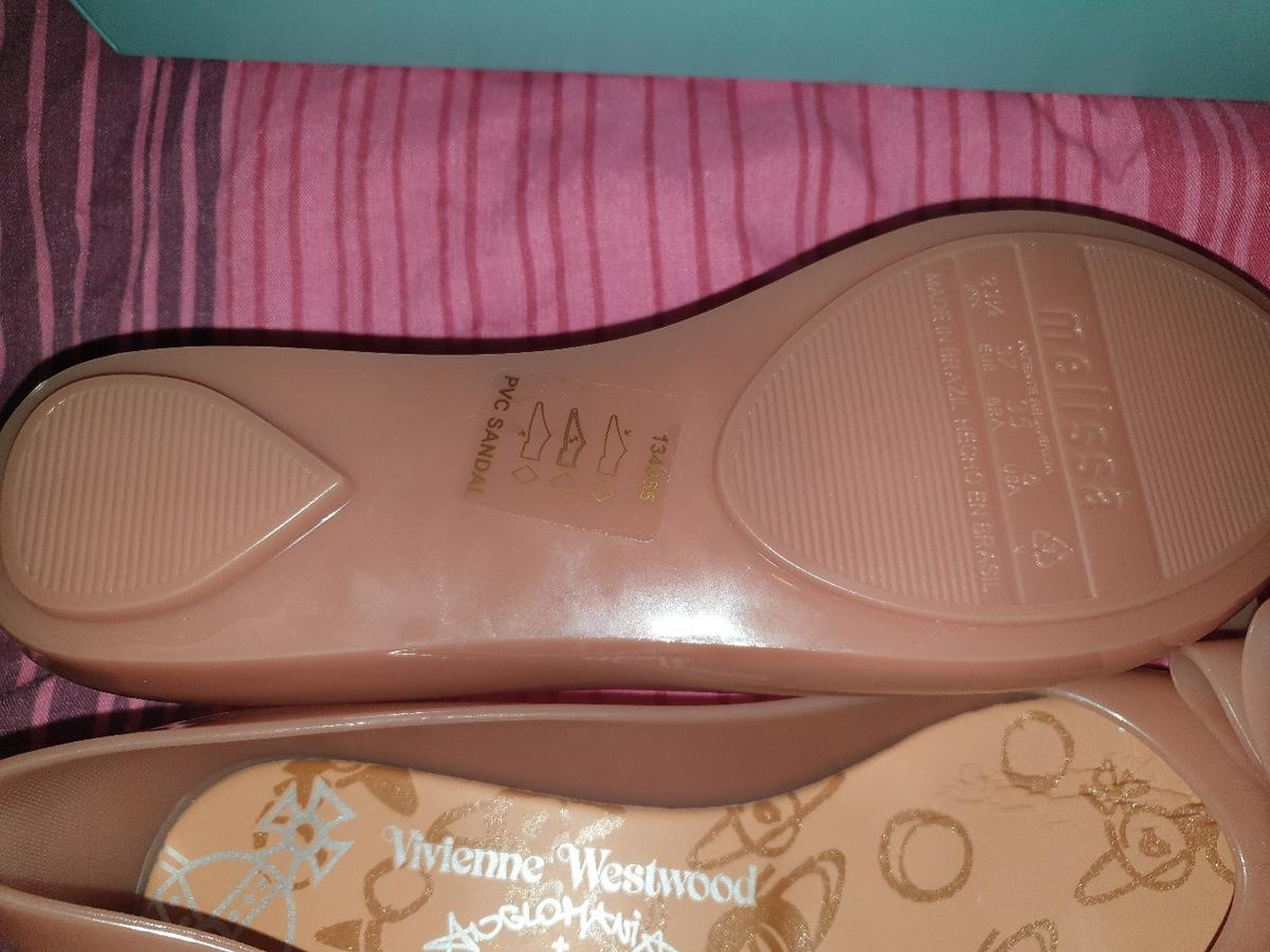 Genuine Vivienne westwood and melissa shoes. Nude coloured with bow. bought from flannels as an xmas present can't find the receipt to take them back bought for £110. never worn only to try on, size 4