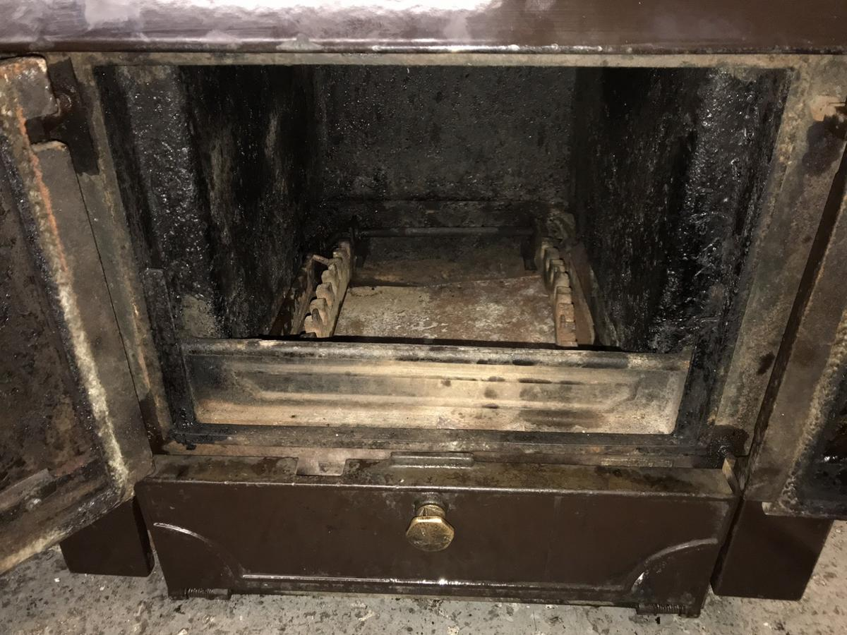 Here is a used Charnwood multi-fuel boiler stove which we have used for about 15 years ,it was in perfect working order when removed from our kitchen in October 2019, if needed it could do with a full set of riddling bars but we have been using a grate in its place ,we have replaced the throat plate with a local engineers made,the thermostat knob is missing ,it has the ash tray ,the left door glass cracked and we replaced it with stainless steel plate ,the right door glass could be cleaned