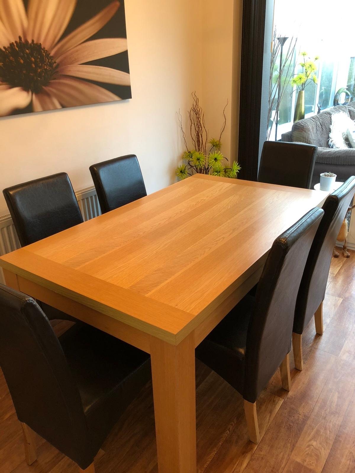 Oak veneer dining room table and 6 brown faux leather chairs. In used condition see photos for wear and tear. Needs gone ASAP. Collection only.