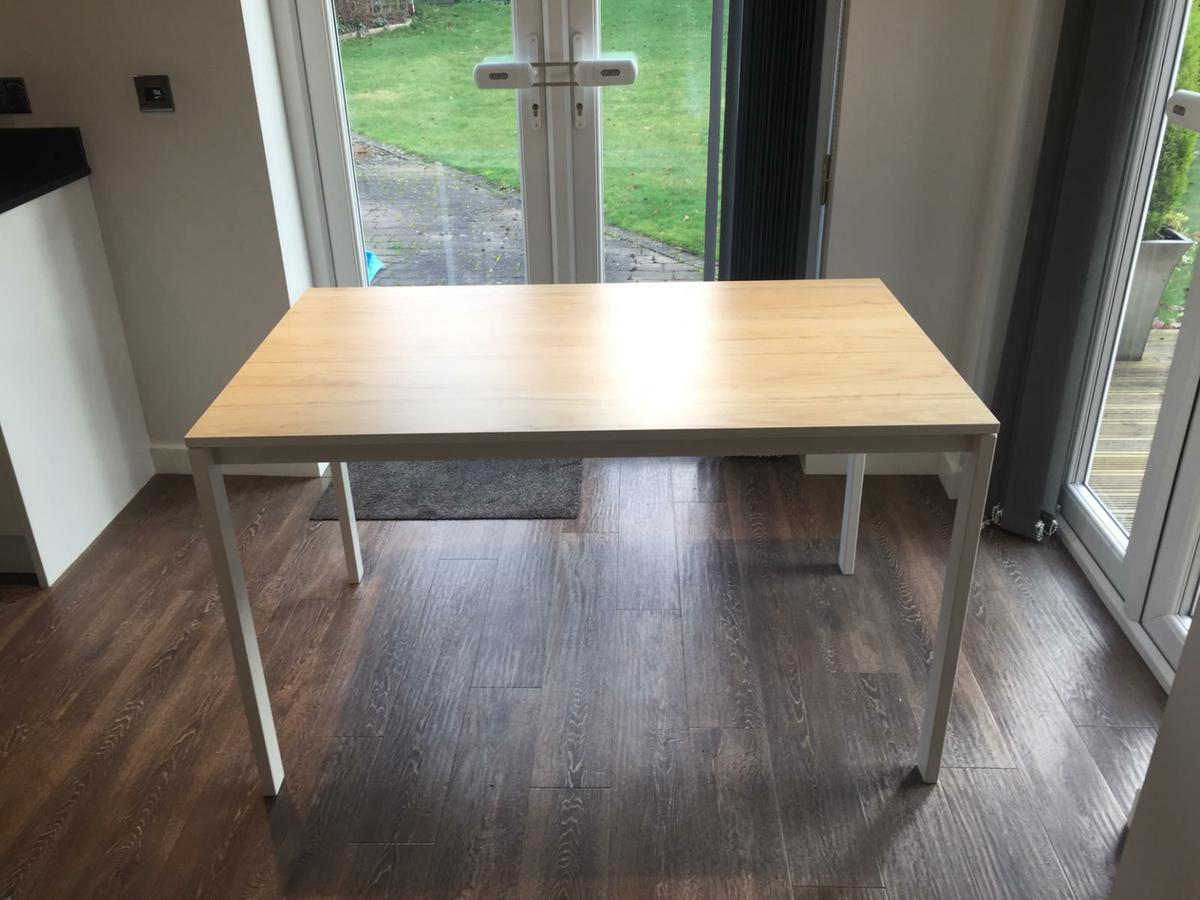 Ikea dining table, less than a year old, as new condition. 125cm x 75cm, white with beige wood effect top. Collection only from B91 Solihull area. Re advertised due to time waster.
