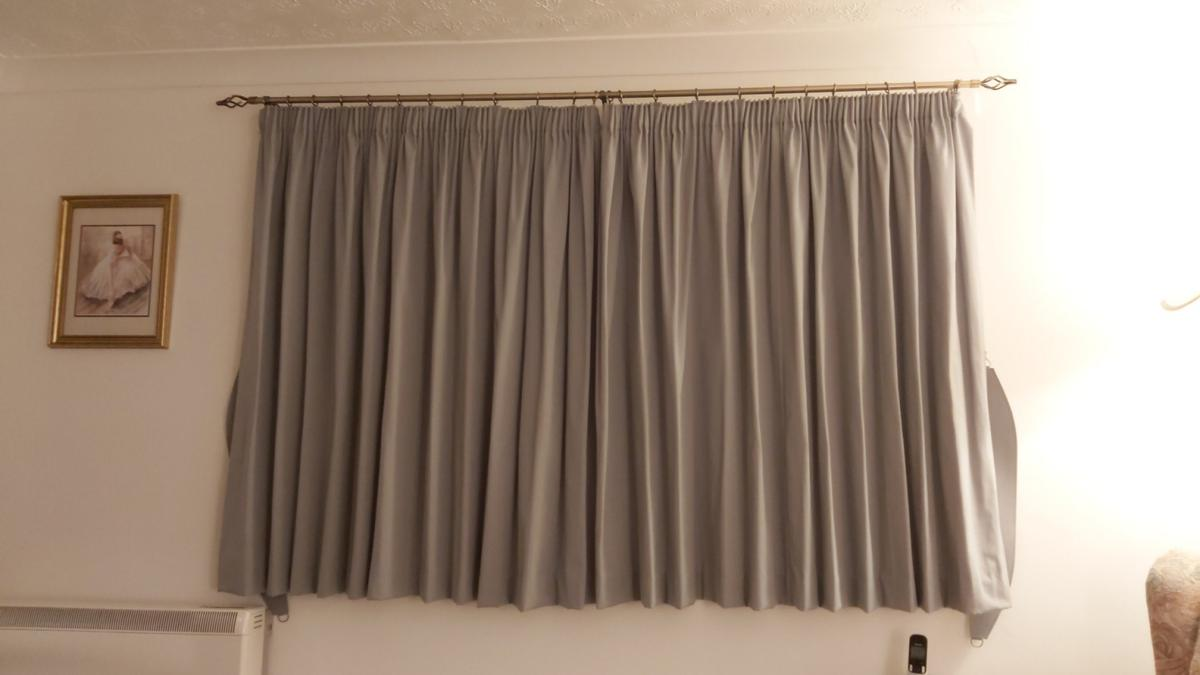 sage green curtains 74 by 54 inches with tie backs . Also have long door one if required for extra 10 00