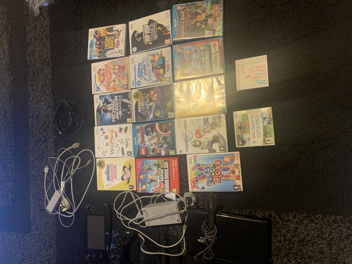 Black wii u, 32gb pre-owned  Excellent condition without box  Extra wireless pro controller along with wii u pad. Charging cables for both pad and controller included.  Built in Mario Kart 8 and Splatoon  With disc games:  Minecraft Super Mario Bros U Super paper Mario Mario Kart wii Bustamove Super Mario Bros wii Lego Avengers Mario galaxy U draw Studio disk Hip hop dance High school musical Babysitting party Michael Jackson the Experience Wii Play Wario Ware Smooth Moves