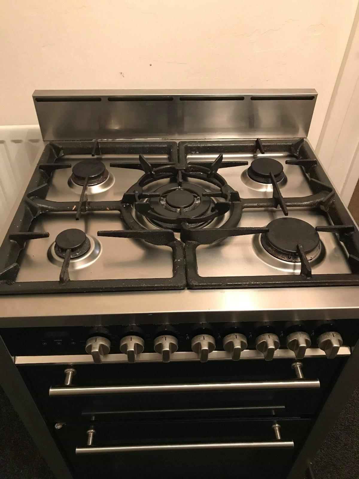 kenwood dual cooker oven is spotless grill needs a deep clean hence the cheap price need it out the way ASAP hence the cheap price aswel