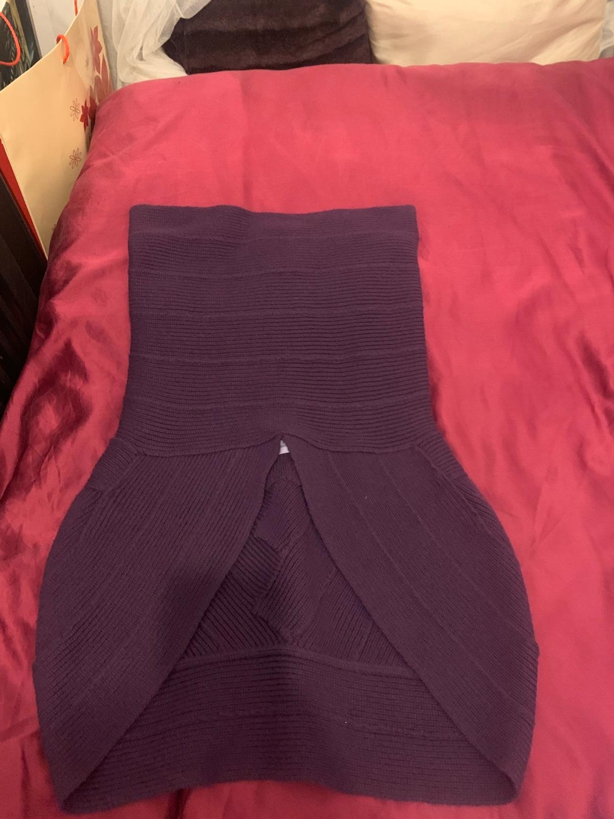 This is a top, longer in the back and w cut in the front. Fits size S- small M