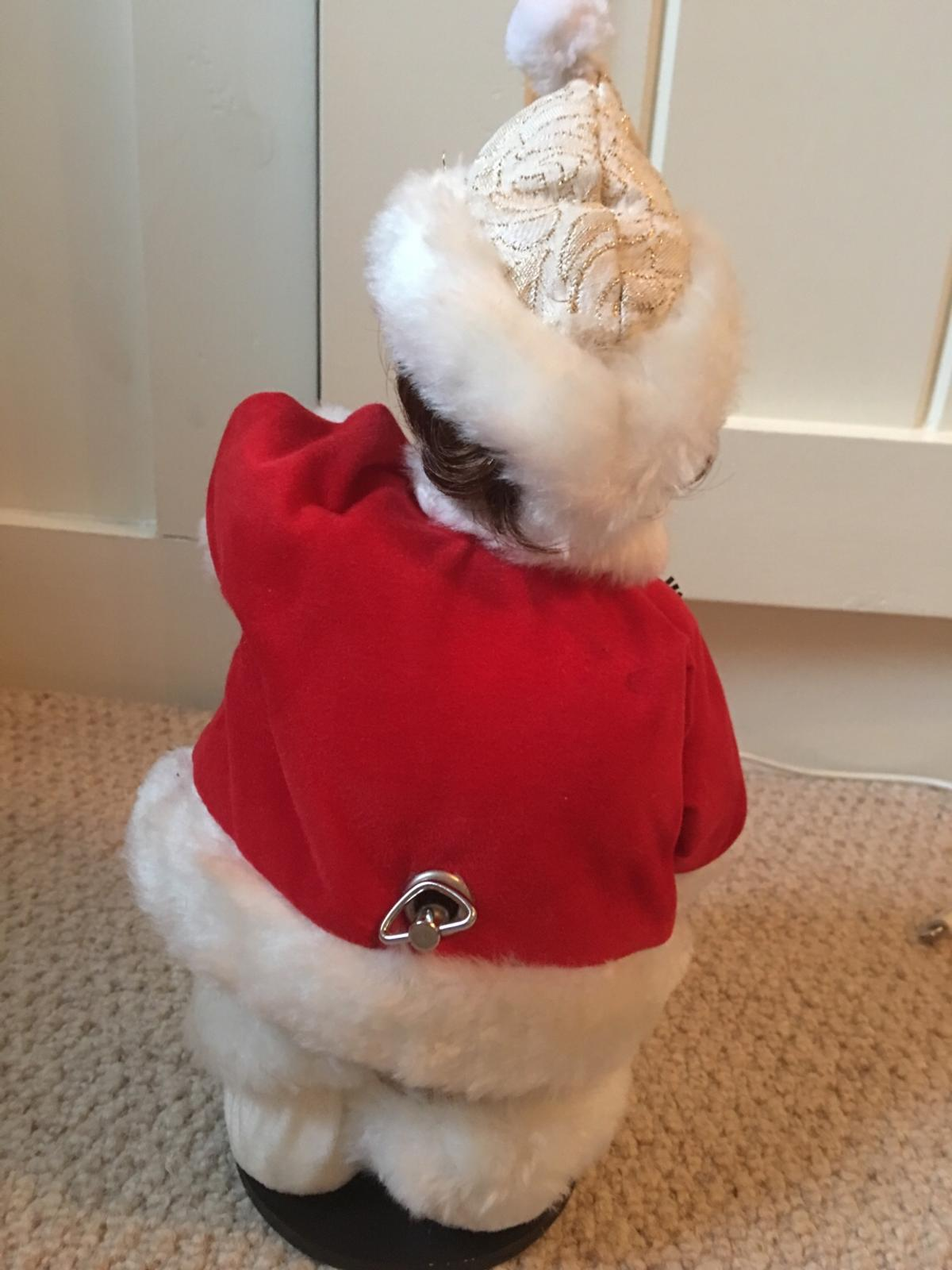 Beautiful pot doll, winds up & plays Santa Clause is coming to town, very good condition