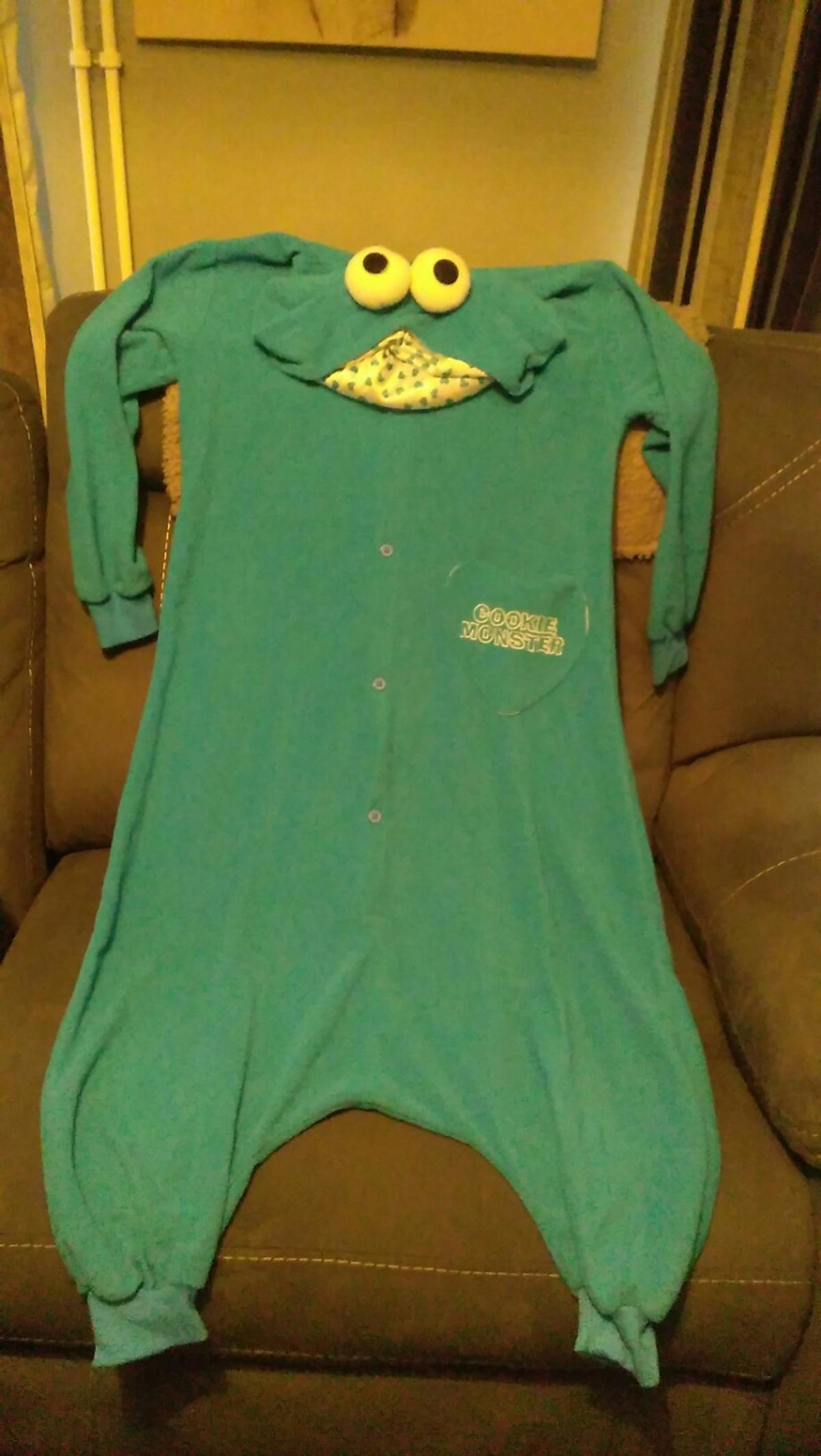 cookie monster drop crotch onesie, size small, good condition from smoke and pet free home..