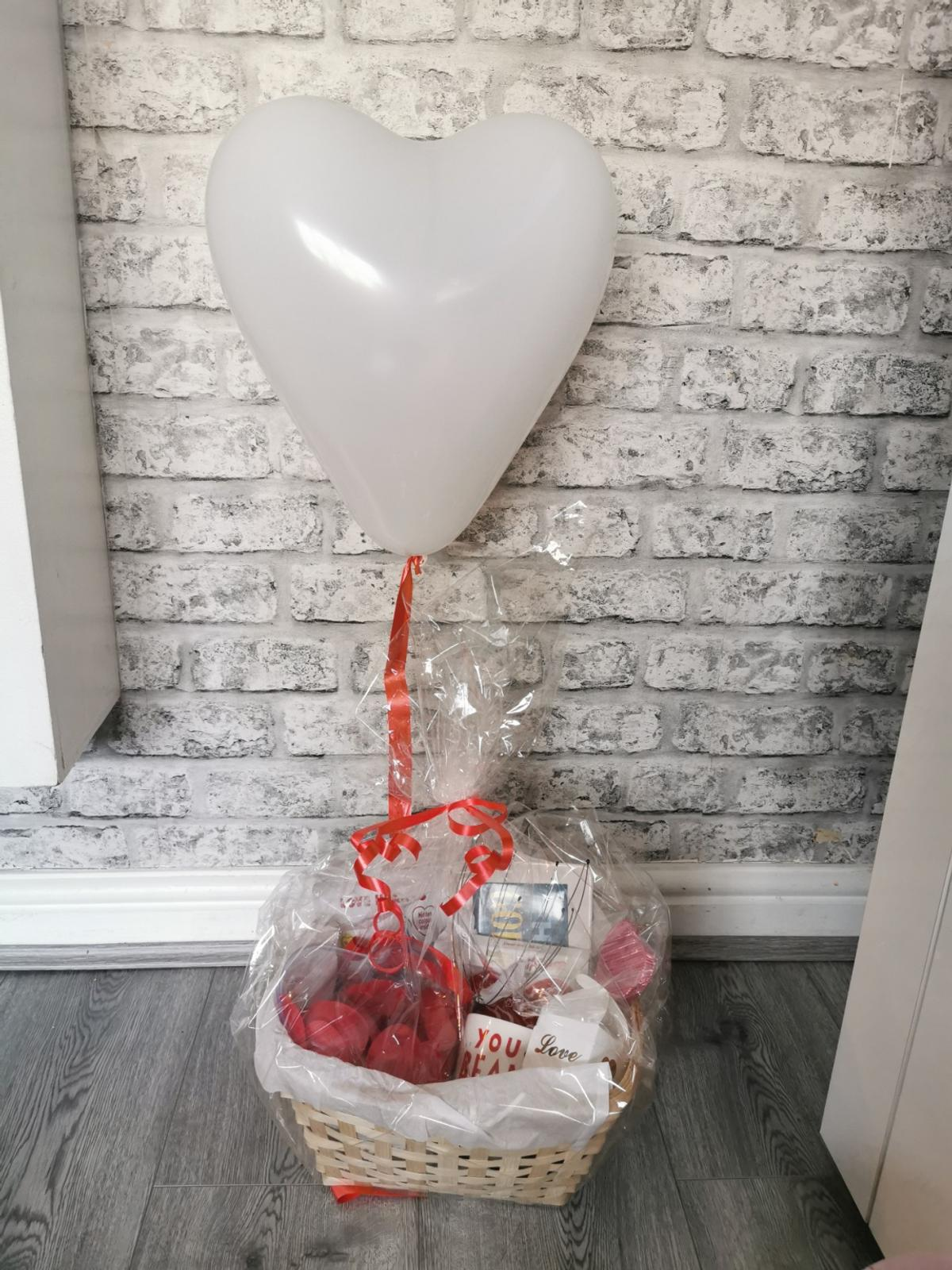 Available to order  Can choose wither red or white balloons  Contains Mug Chocolates Heart lolly Hey gorgeous dresser plate Heart of rose petals Massager Bath bomb Heart bubble keepsake Heart Card holder Heart hand warmer  Personalised tag added to each one with your own stamped messages
