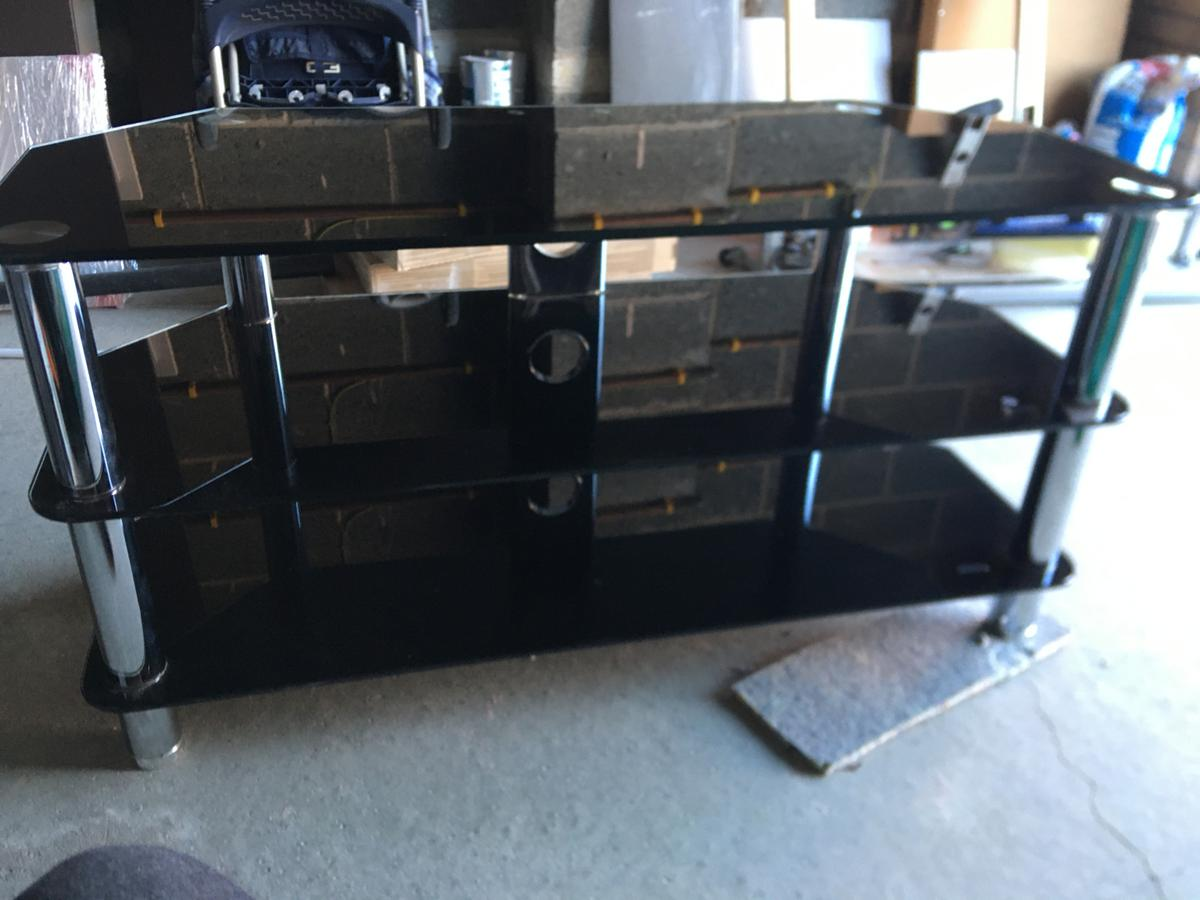 Black and Silver TV Stand with 3 shelves for storage. Will Fit any size TV.
