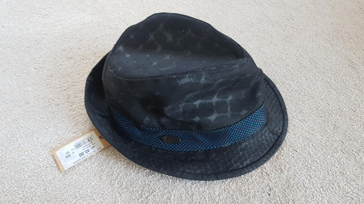 this hat been stored but new with tags and unworn size 3 feels like medium. i am usually large 59 and is bit small but still fits.
