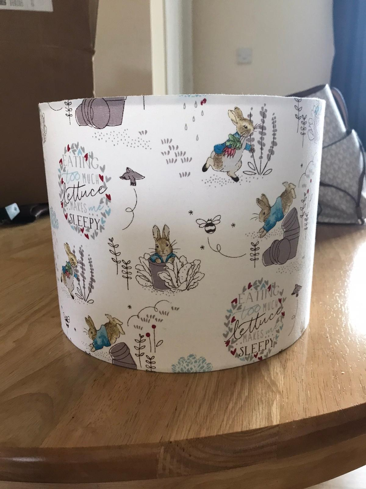Brand new peter rabbit lampshade. Handmade 100 cotton fabric.  Lampshade size is 25cm. Lampshade has PVC lining which is flame retardant.  Beautiful accessory to any nursery.