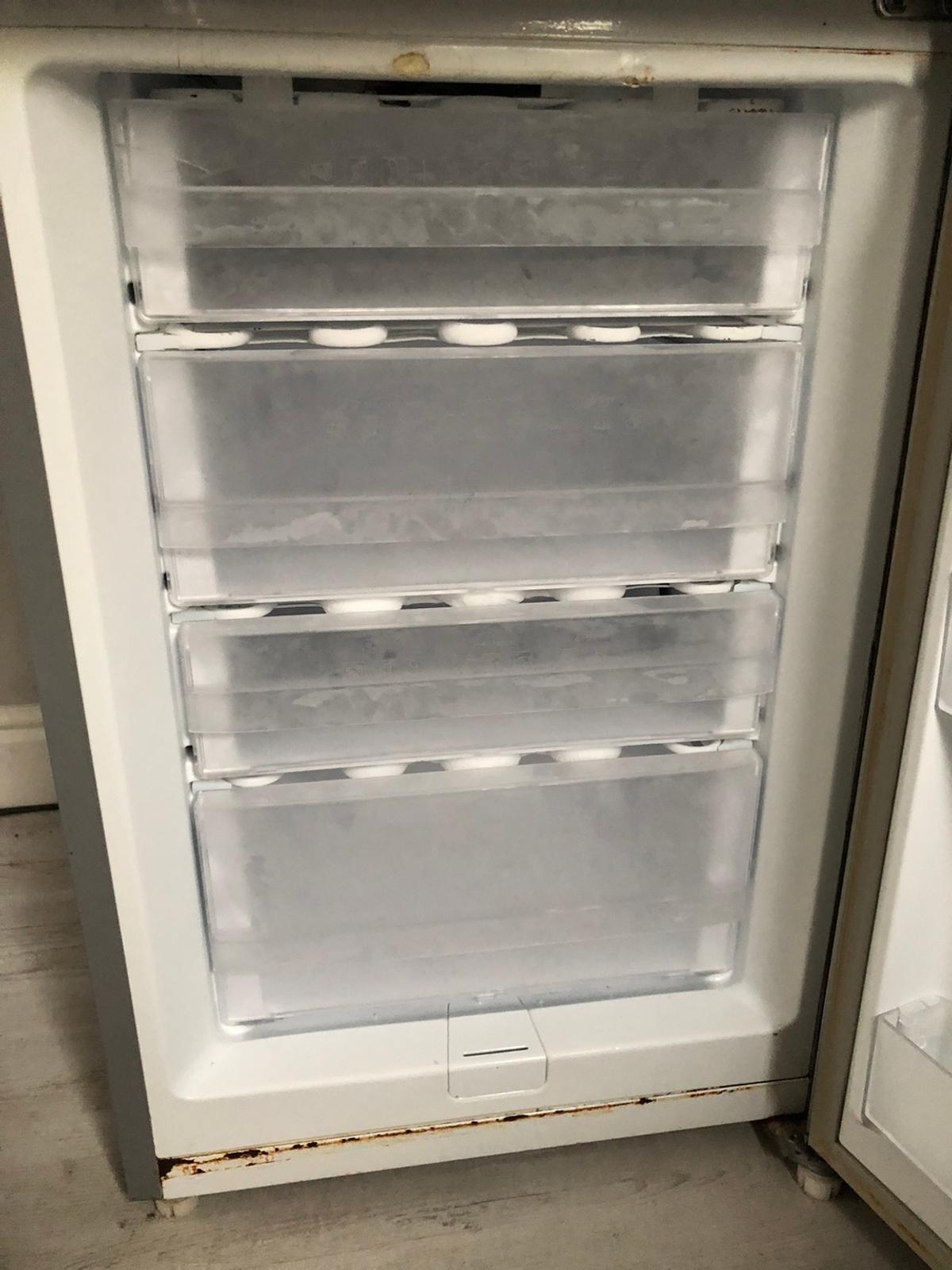 Used Samsung Grey fridge freezer £40  Outside visually in great condition, inside see pictures - does not affect use. Top tray of the freezer one side of the clips are broken.  Selling due to moving into home with built in one.  Collection only, Chester road (Boldmere) Will be defrosted the 17th and available for collection 17th-21st Jan (unless specially requested otherwise)