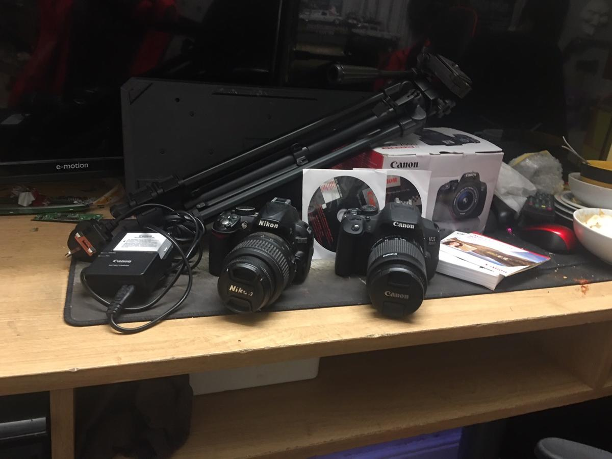 Included is a canon 700d with original box and accessories and a Nikon d3100 without charger but comes with battery. There is also a velbon tripod. Comes with bag also.Open to offers
