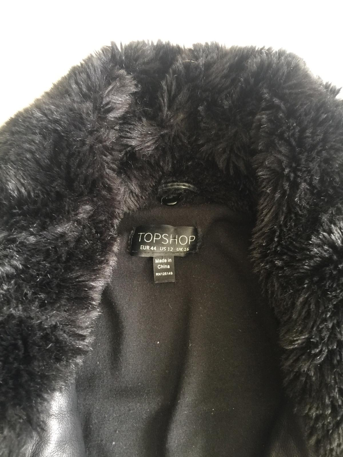 Leather jacket ( not real leather) short jacket . With detachable fur . Very good condition. Size 16 from top shop