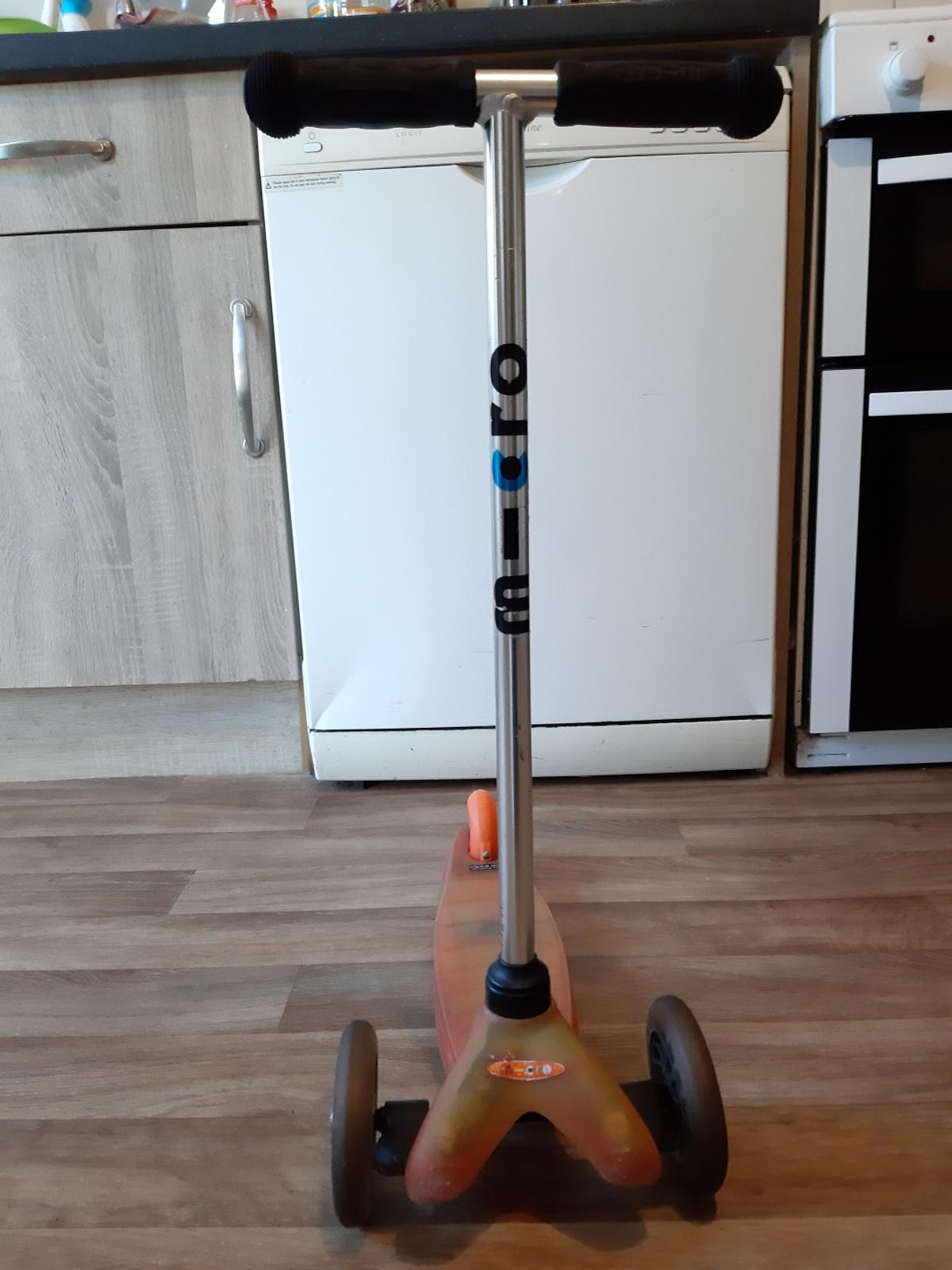 Clear Orange Micro scooter Break/Wheels Working Perfectly Fine In Really Good Condition