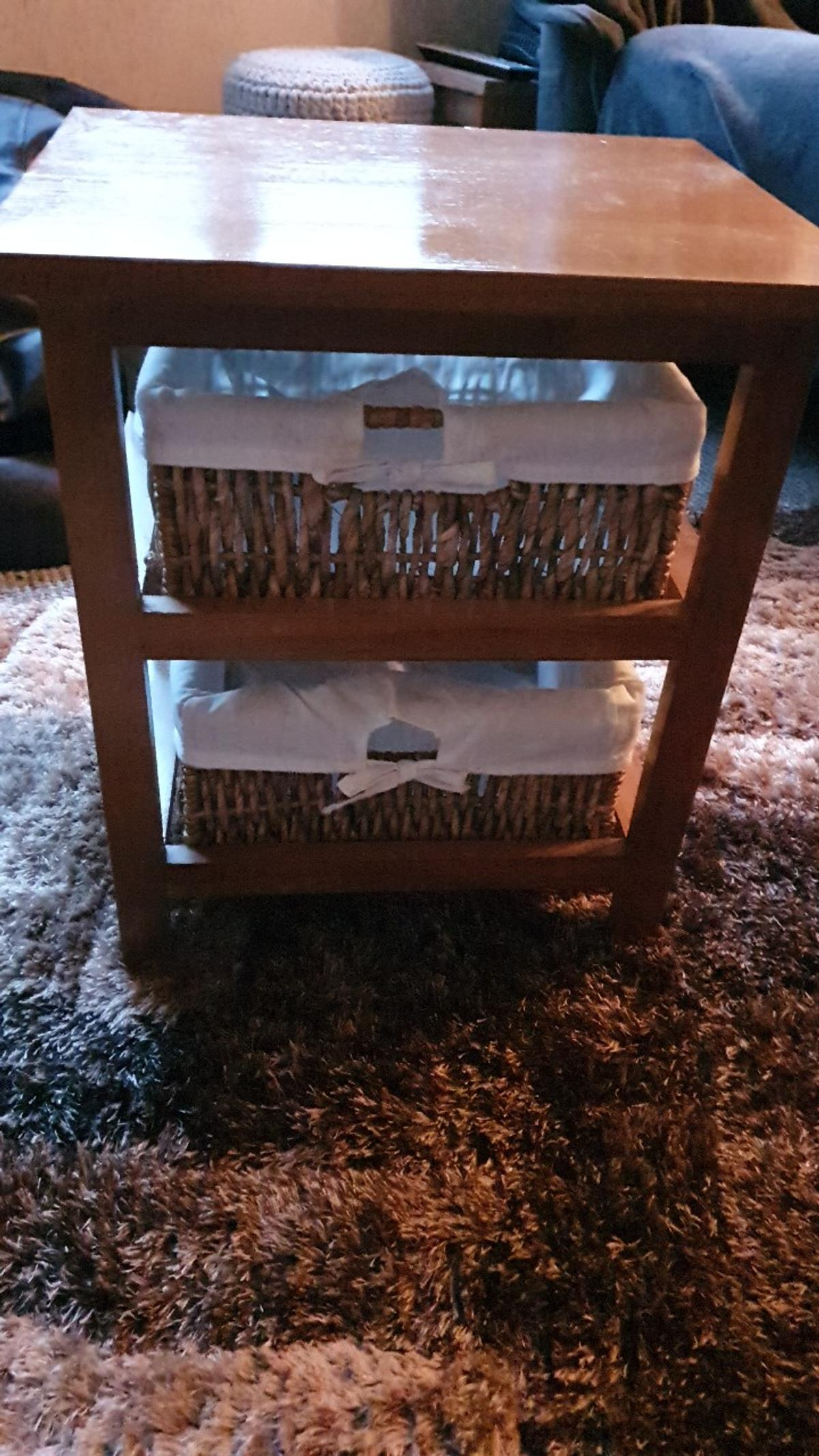 size of a bedside cabinet. 2 wicker drawers. good condition. only a few months old.