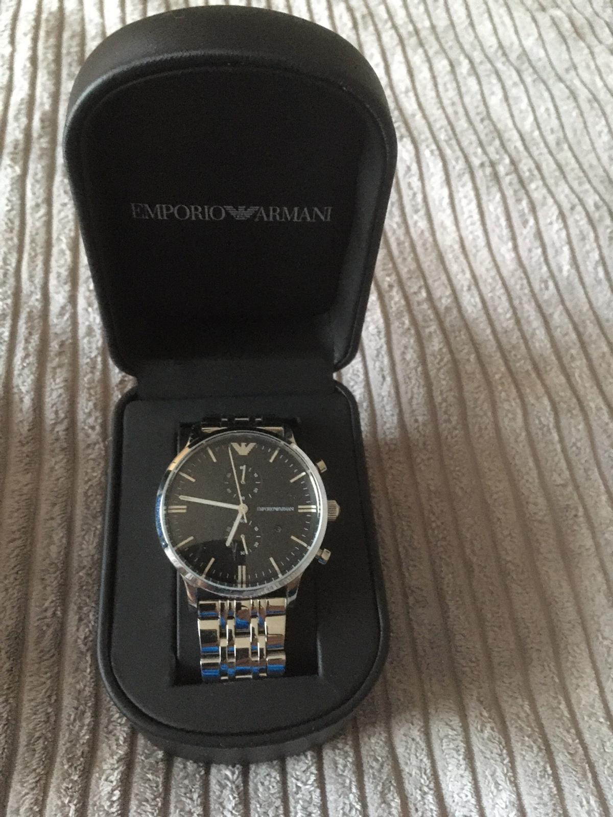 Basically brand new. Worn 3 times comes with extra link works perfect.very tiny scratch on the face hardly noticeable £70