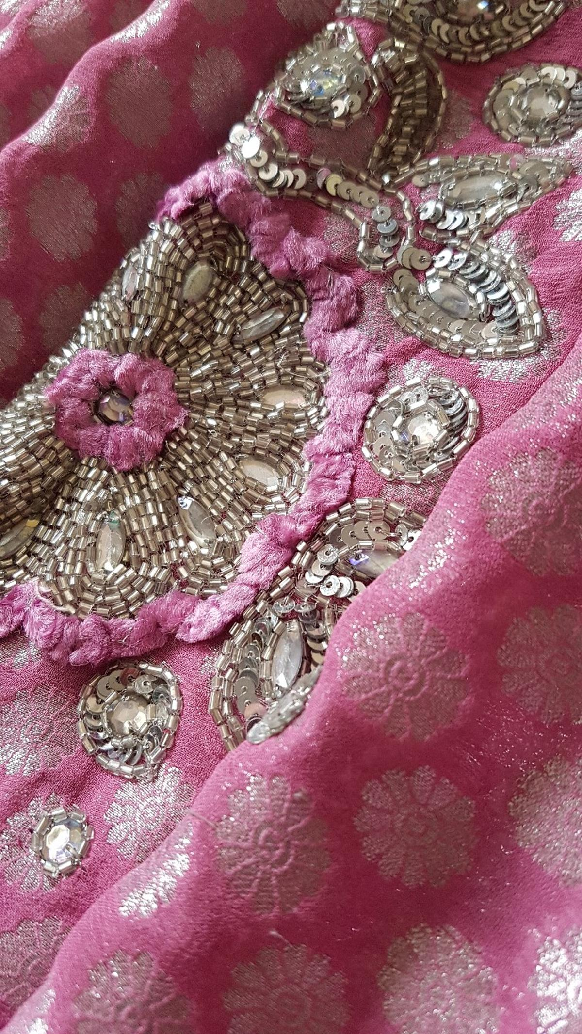 Brand new pink half net saree with beautiful silver sequence embroidery throughout the saree n the blouse which is standard size. Rrp £225 now selling at a bargain less then half price. Can pay by PayPal Collection or can post for the cost of p&p NO TIME WASTERS NO OFFERS PLS