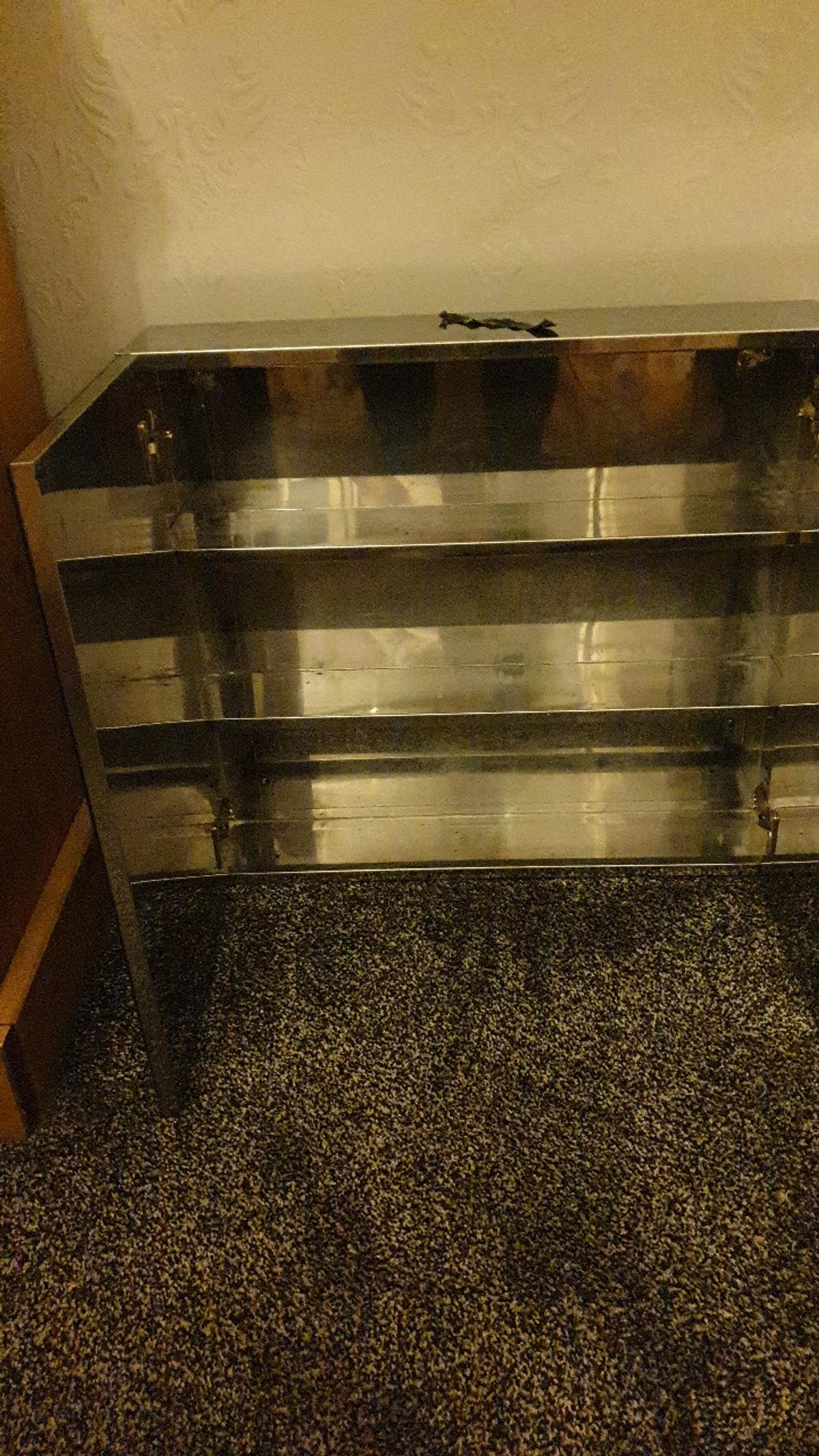 stainless steel 3 shelf bath cabinet . good condition with mirrors. buyer collects , no offers no time wasters a good buy.
