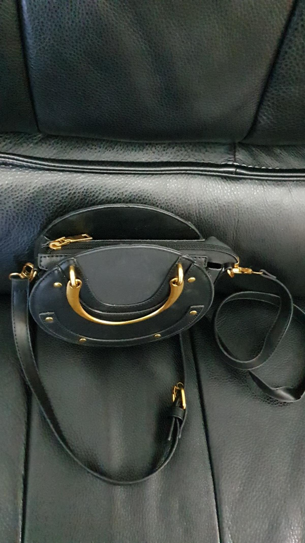 Lovely new black shoulder handbag. Never used, only stored. No tags. Can be used as a cross body bag too has adjustable strap, and inside pocket.  Please see my other items