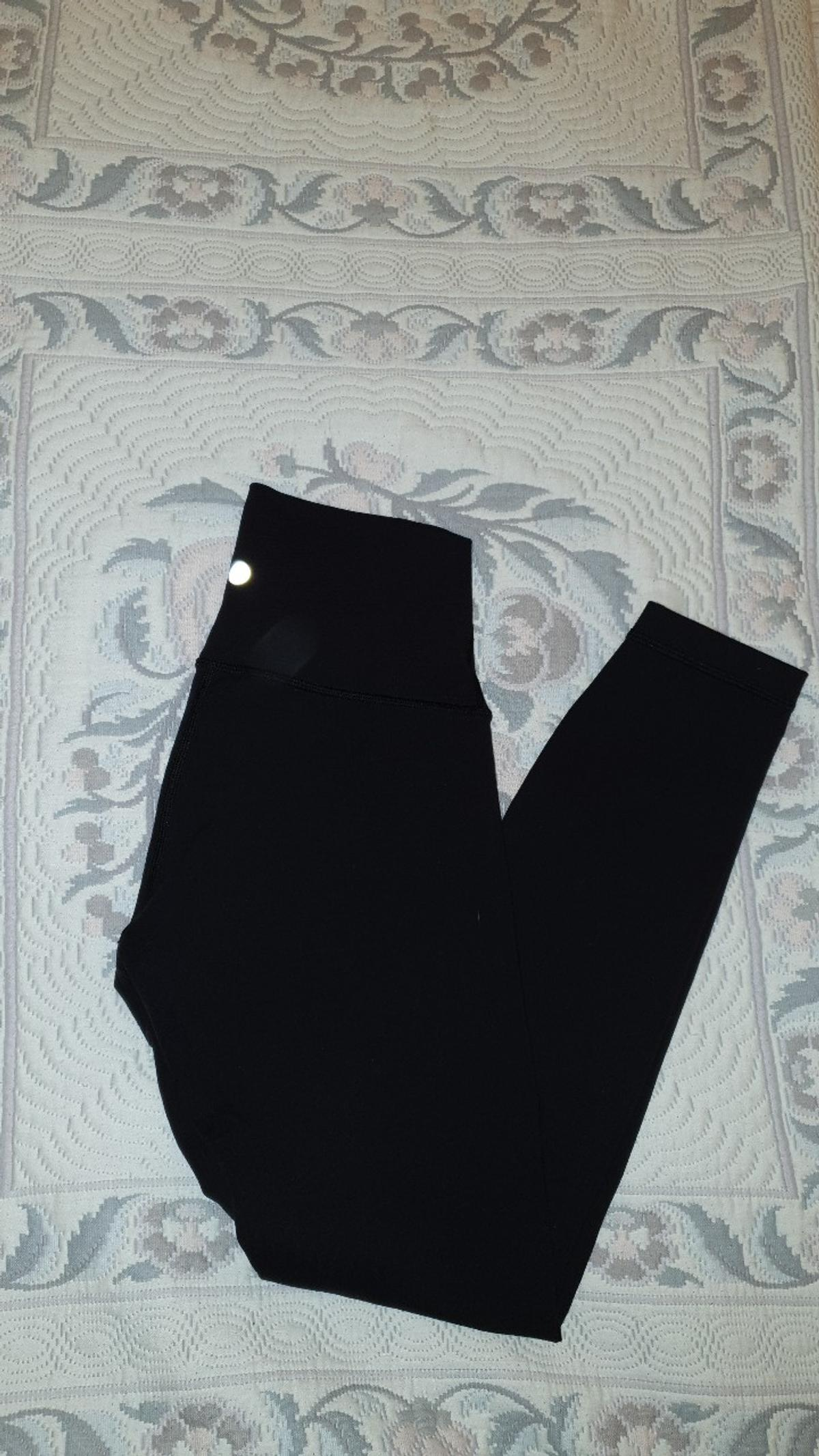 lulu lemon wonder under leggings size 4 (UK 6/8) black. thicker than lulu aligns so more suitable for outside or colder weather. they are slightly tighter than aligns so give extra support around legs and stomach which aligns don't. They come with a card/key holder inside of the waist band. worn a few times. selling as too many leggings. good condition. bought for £78. no interior label as I cut it out for comfort purposes.
