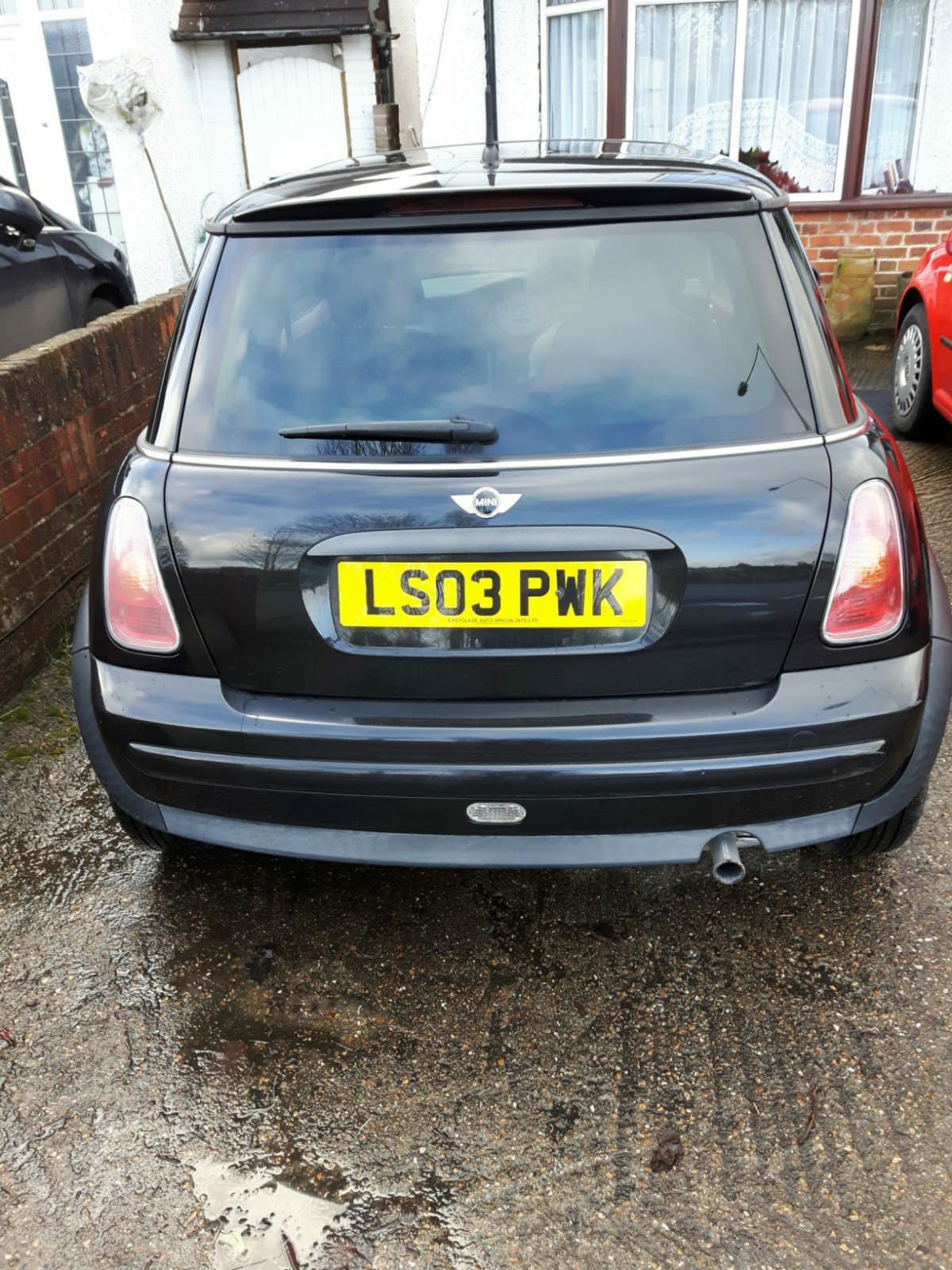 Mini Cooper 1.6 very low mileage , Black ,glass sunroof 1 years MOT , history .