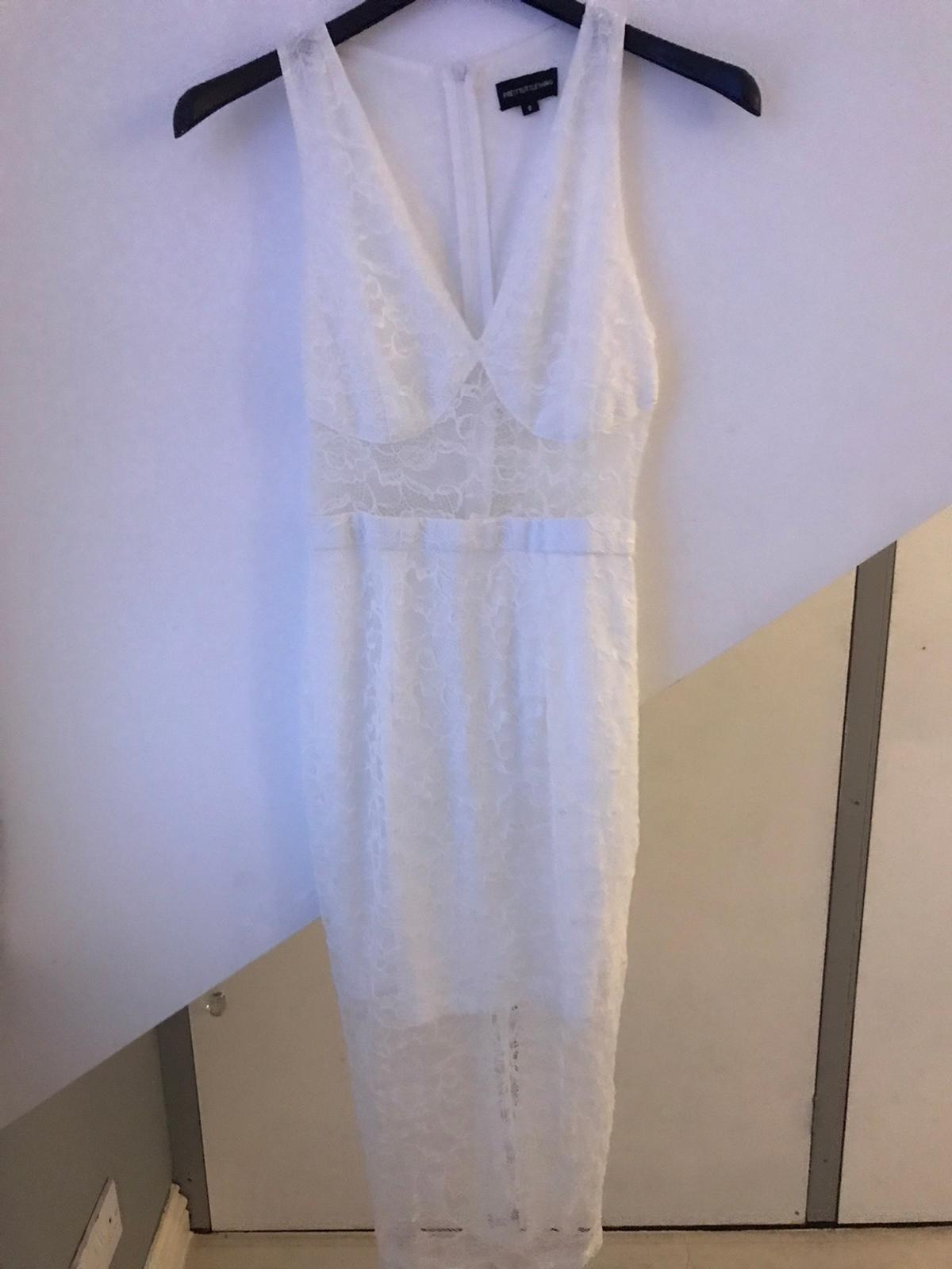 Pretty little thing white lace dress. Bought for a wedding , only worn once. Size 8 OPEN TO OFFERS