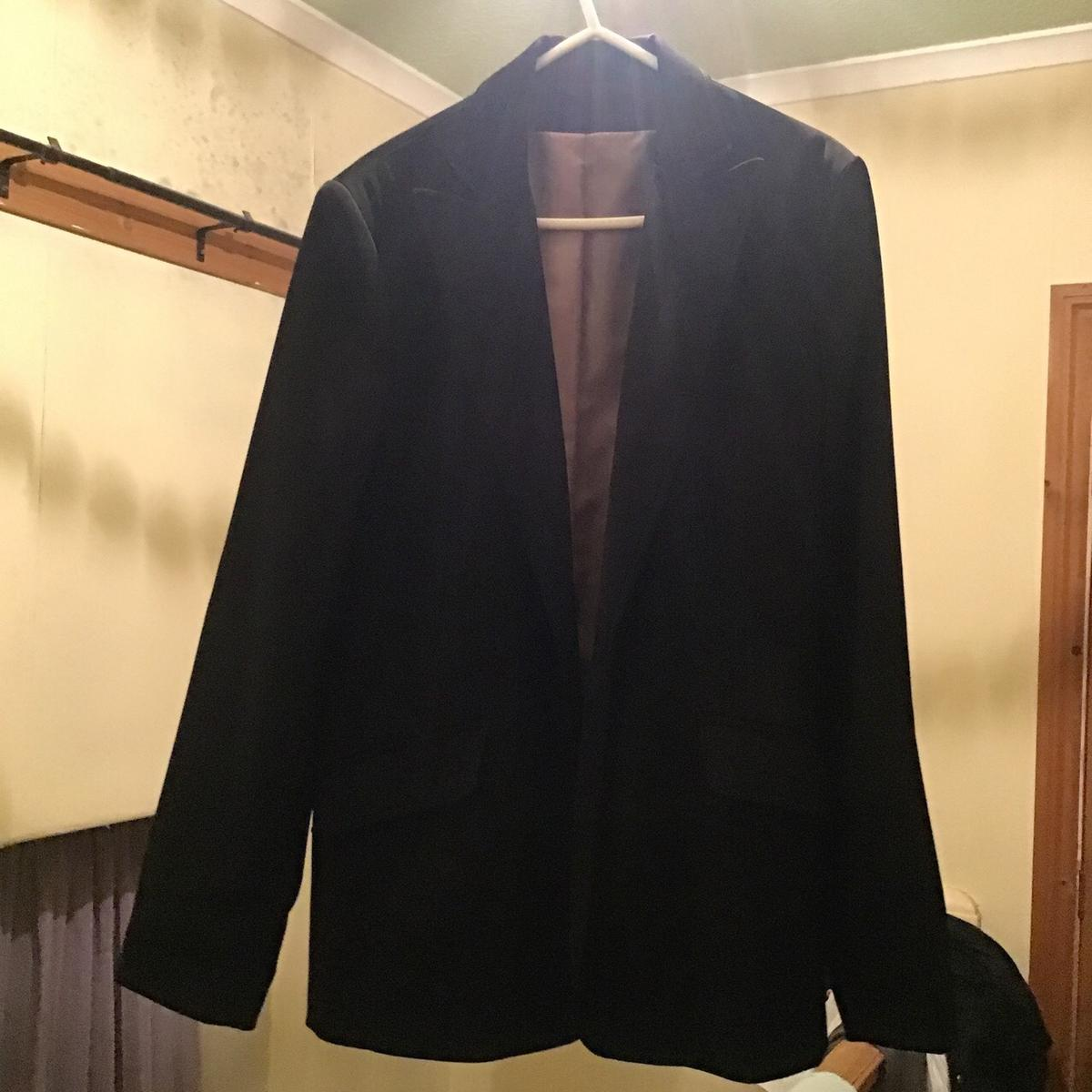 Little black jacket size 14 Really nice item hardly worn Has pockets either side and one button to choose either to fasten or wear loose. Fold sleeves to wear stylishly with a dress or some jeans or wear for a more formal wear.