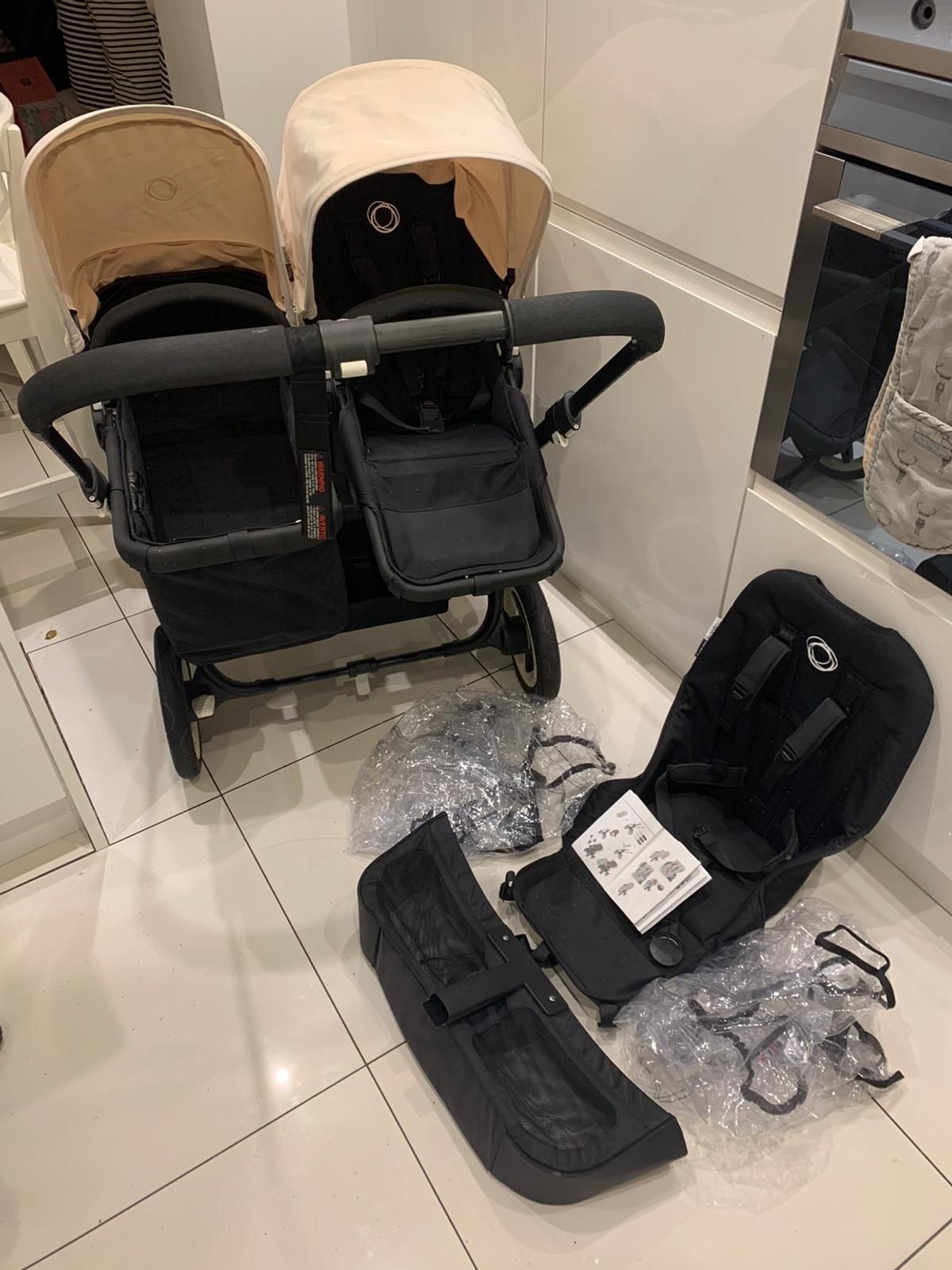 In great condition comes with two rain covers two seats one carrycot two cream hoods and basket all black frame