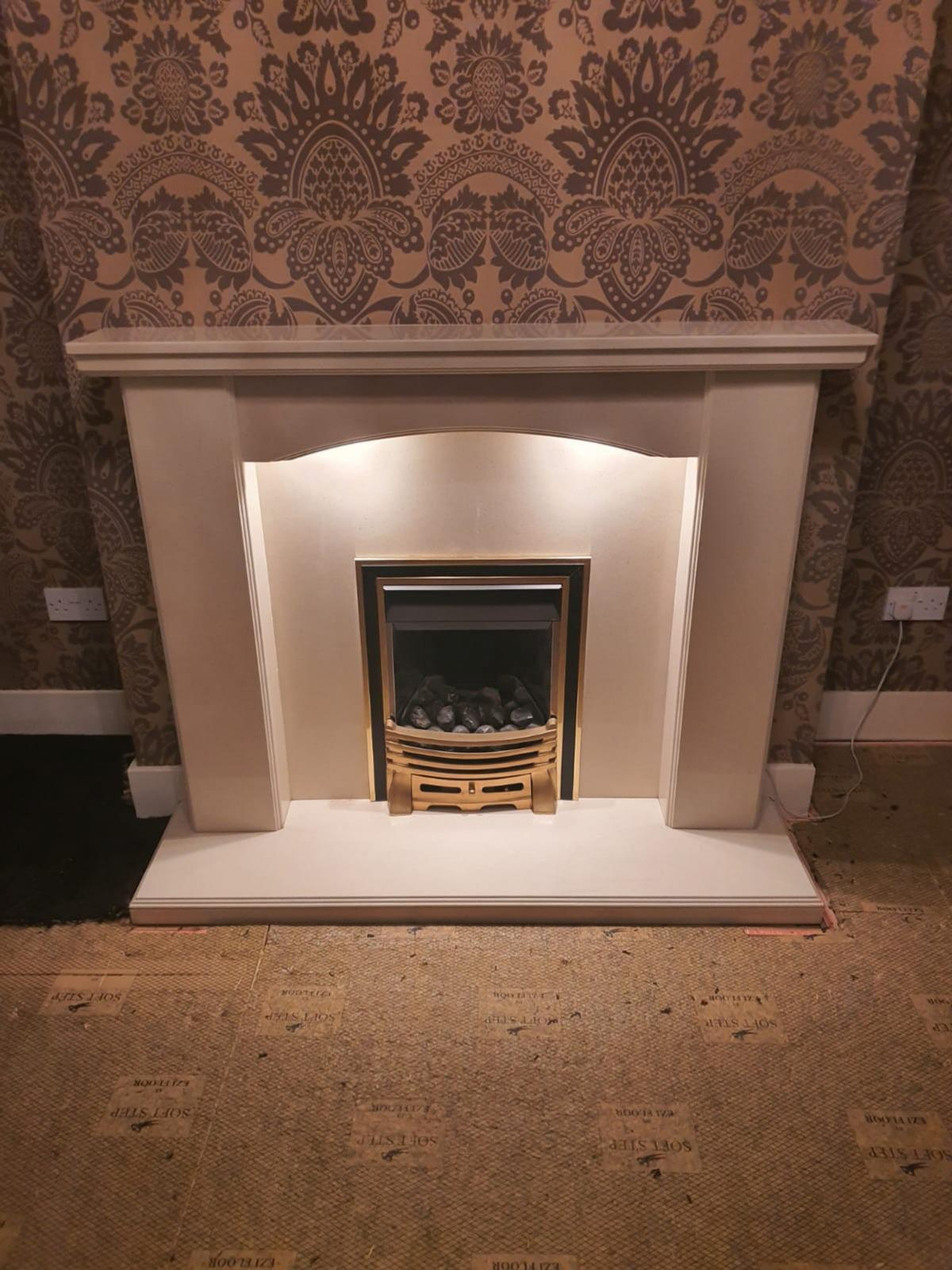 A cream marble fireplace which comes with the gas fire and coals.  There are two downlights integrated into the marble. These are easily turned on or off via a small discrete switch.  Very easy to fit, and connected via a socket plig. I have paid a professional to safely remove the fireplace without damage.  In very good condition. Barley used.  £150. Serious buyers only  Measurements:  Height - 110cm Width - 136cm Depth 36cm