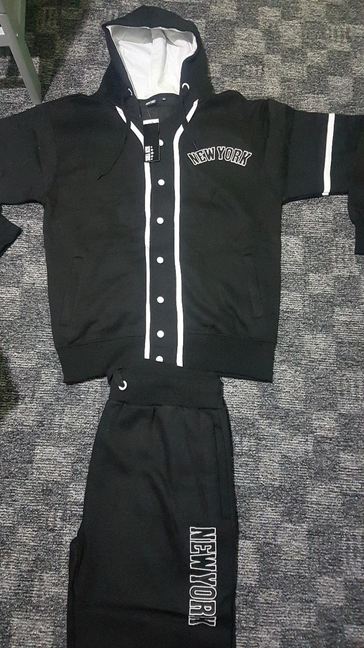 New York girls and mens tracksuite. Nice and warm. Brand new. Sizes available XL Hoodie with 2 side zipped pockets. Trouser with 2 side pockets and 1 back pocket. P&P AVAILABLE WITH EXTRA £3.50