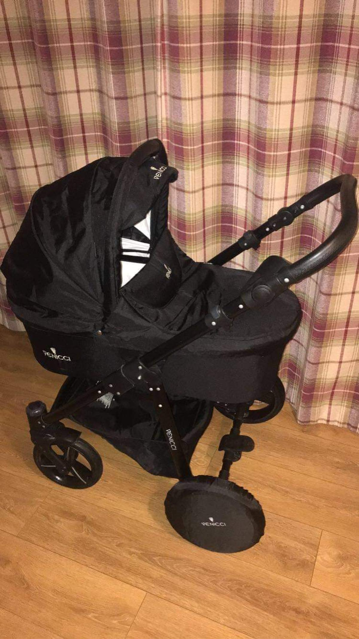 2 in 1 Black Venicci pram.. carrycot and pram seat.. Purchased for £550.00.. wheel covers, drinks holder and rain-cover included.. Excellent condition. Was used for 4 months - £120 o.n.o  Proof of purchase can be provided