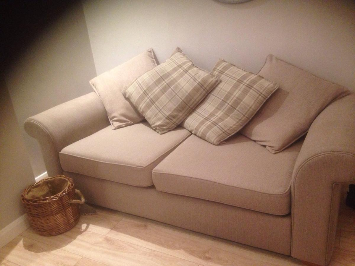 Taupe/ beige good condition, 1 sofa has mark on arm (glue) on inside of arm shown in picture could be used with a throw other then that good condition no damage