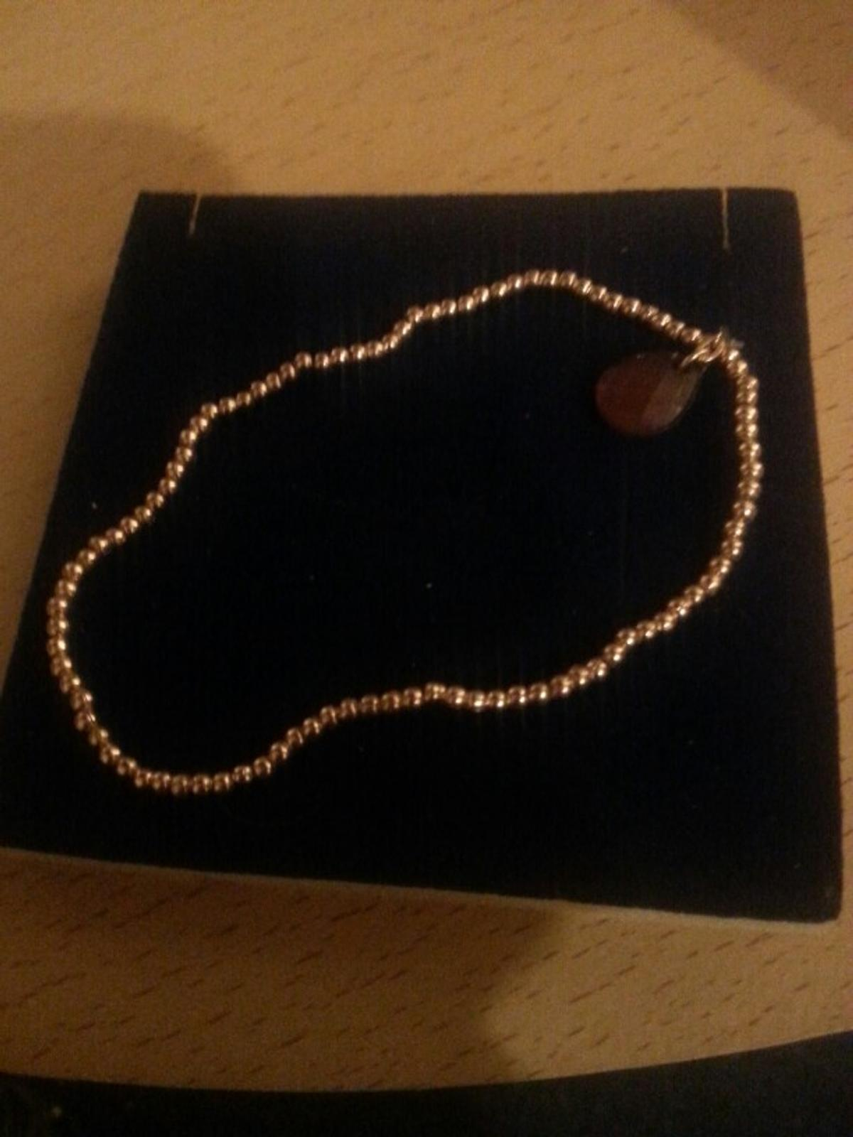 LADIES GOLD TONE BRACELET WITH SMALL STONE.....COSTUME JEWELLERY.I CAN POST.