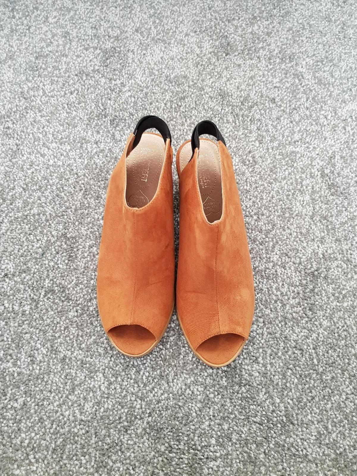 I have for sale a pair of size 4 tan peep toe sling backs from pet and smoke free home
